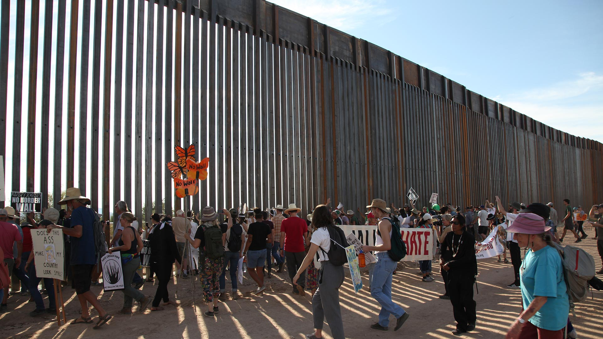 "The crowd pounding on the U.S. - Mexico border wall chanting ""tear down this wall"" during a protest in Organ Pipe Cactus National Monument, Saturday, November 9, 2019."