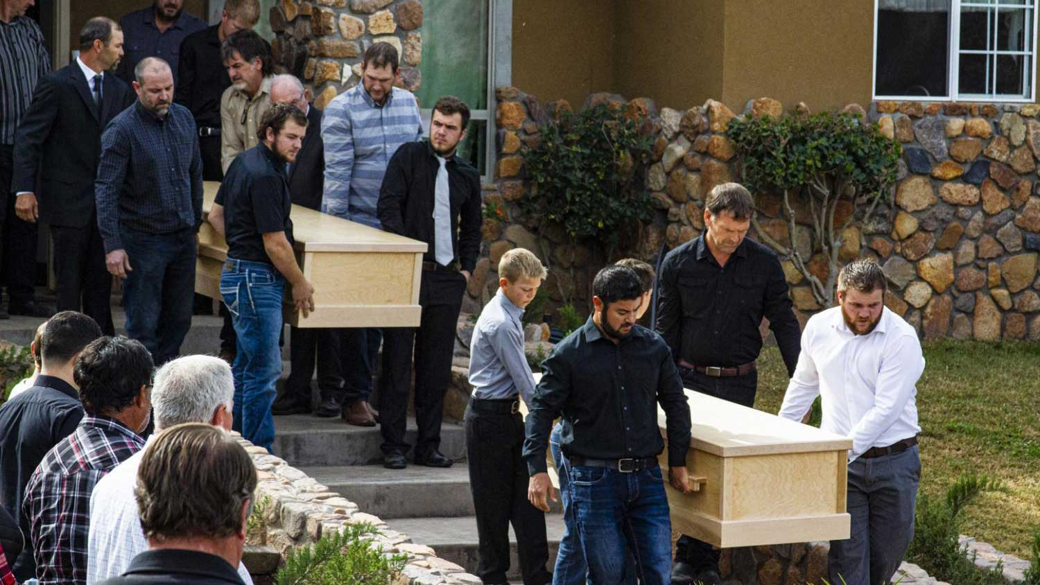 Family members carry caskets toward the ceremony on Nov. 8, 2019, for three of those killed in the vicious attack against a small Mormon community in Sonora on Nov. 4, 2019.
