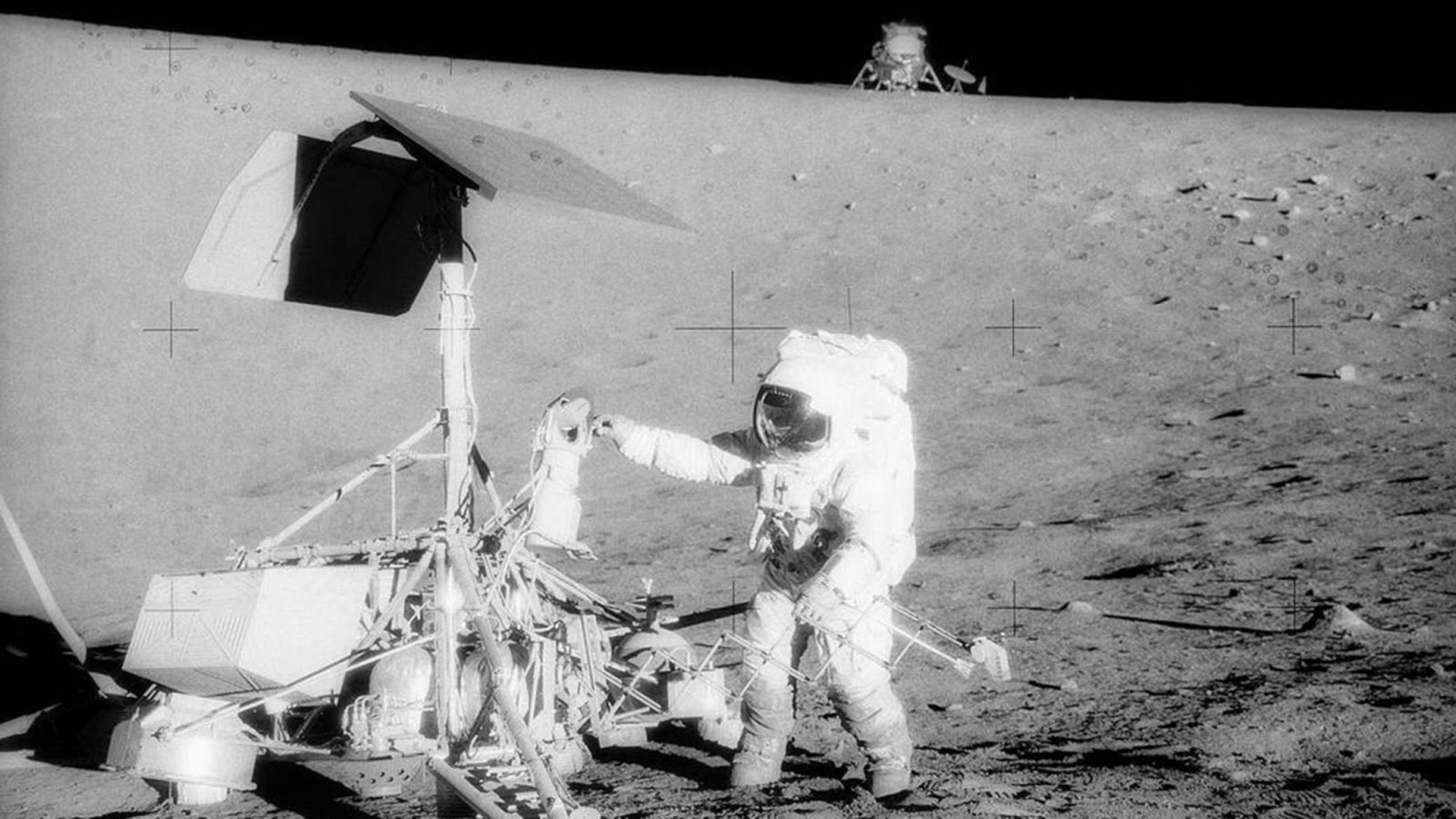 Apollo 12 astronaut Alan Bean inspects Surveyor 3