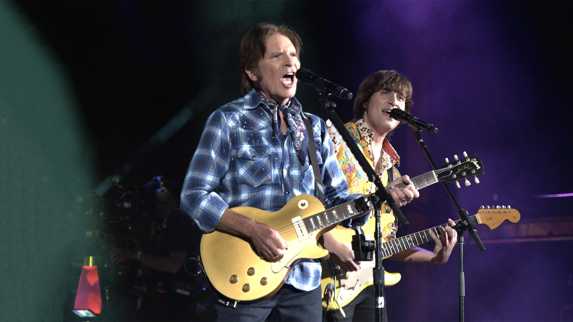 John Fogerty performing with his son Shane in JOHN FOGERTY: MY 50 YEAR TRIP, inspired by the 50th anniversary of Woodstock and John's hit parade with Creedence Clearwater Revival