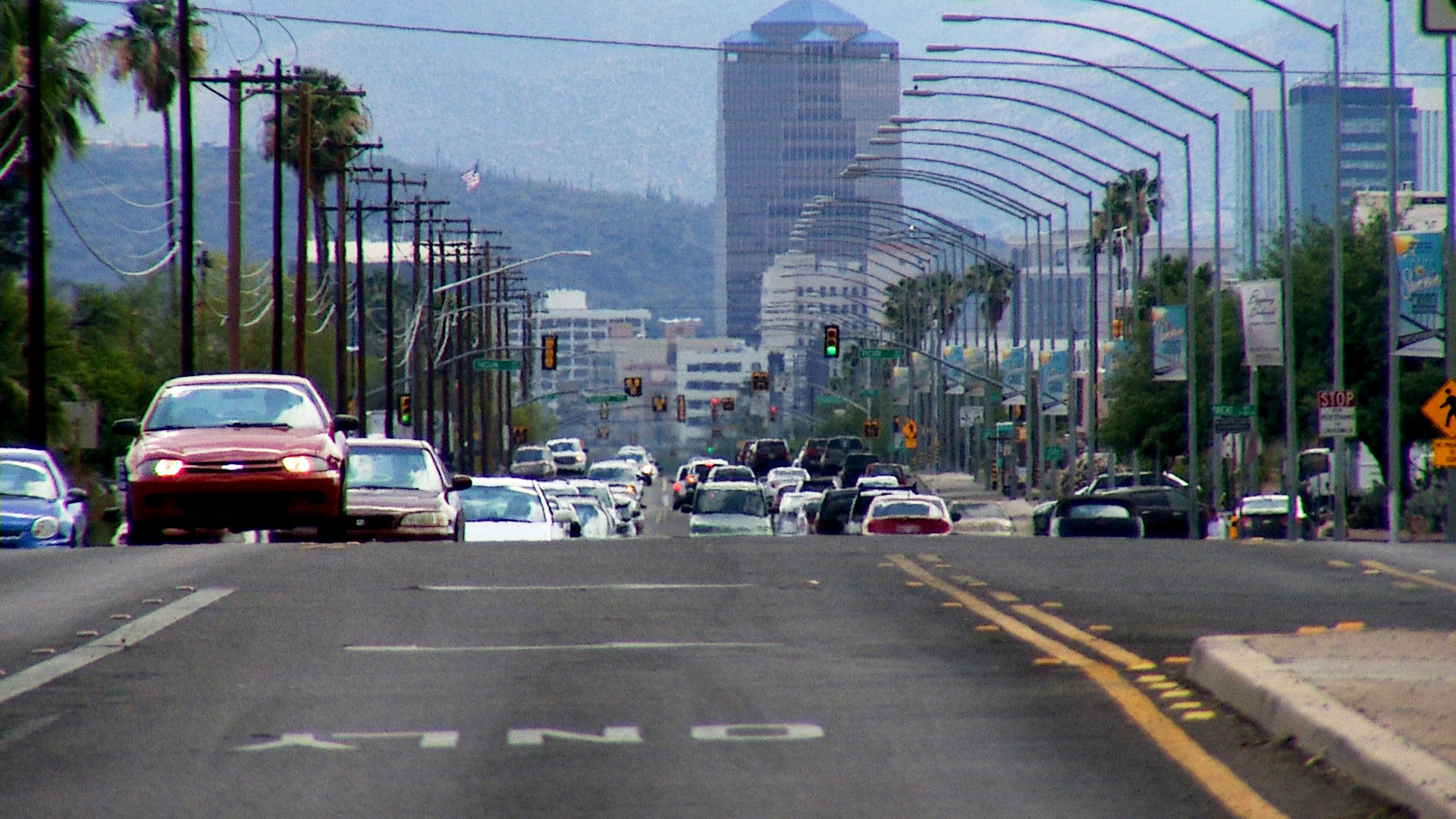 Downtown Tucson is seen in the distance from the intersection of Broadway Boulevard and Country Club Road.