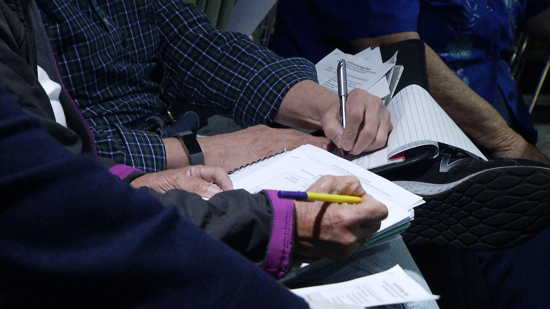 Attendees take notes during a workshop hosted by the Pima County Democratic Party about how to become an Arizona delegate at the 2020 Democratic National Convention. The workshop was held at the Nanini Library on November 13, 2019.