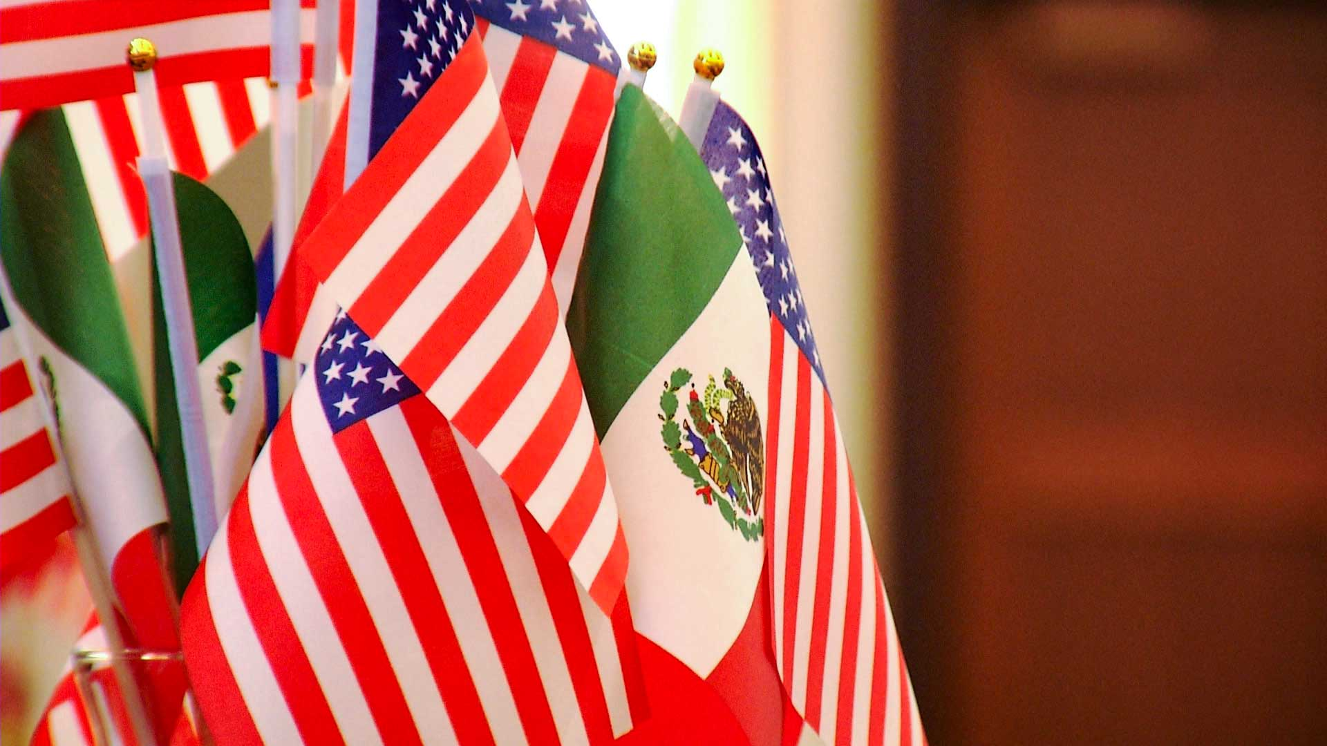 U.S. and Mexico flags.