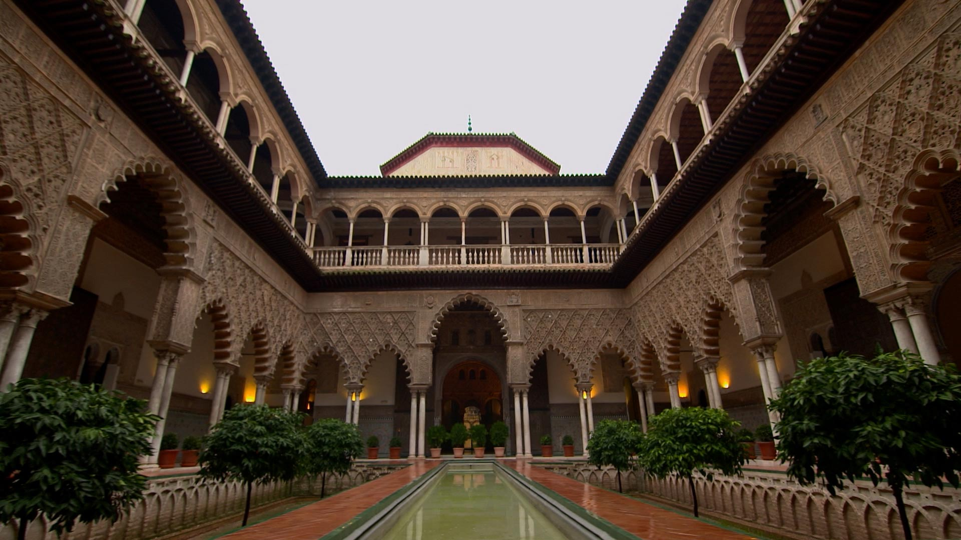 In the mid-14th century, Muhammad V sought asylum at the Alcazar in Seville, the home of Pedro I. The two men shared an appreciate for each other's architectural taste and accomplishments. After Muhammad returned to the Alhambra, he built the Court of the Lions which is highly influenced by Pedro's courtyard.