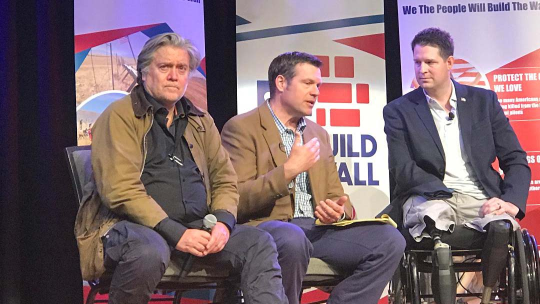 "Steve Bannon, left, former adviser to President Trump, is joined by former Kansas Secretary of State Kris Koback, and Brian Kolfage, founder of ""We Build The Wall,"" during a private event at Quail Creek Country Club, Feb. 8, 2019."