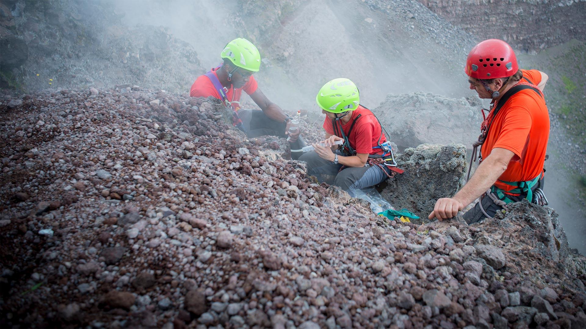 Chris Jackson, Rosanna D'Arienzo and Berardino Bocchino collecting gases from Vesuvius crater.