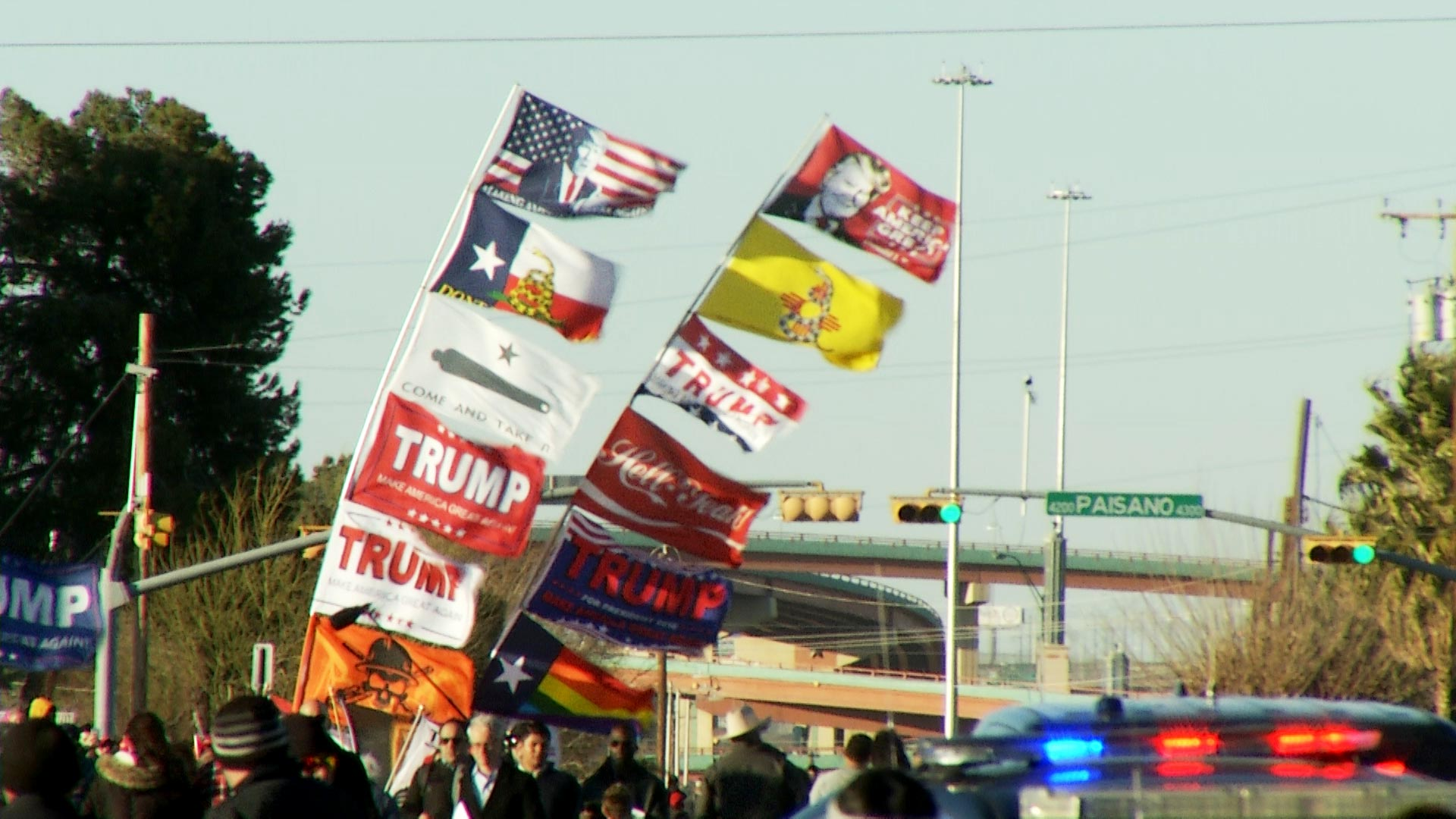 Flags flying in support of President Trump blow in the wind outside the Coliseum Box Office in El Paso, Texas where President Trump held a campaign rally on February 11, 2019.