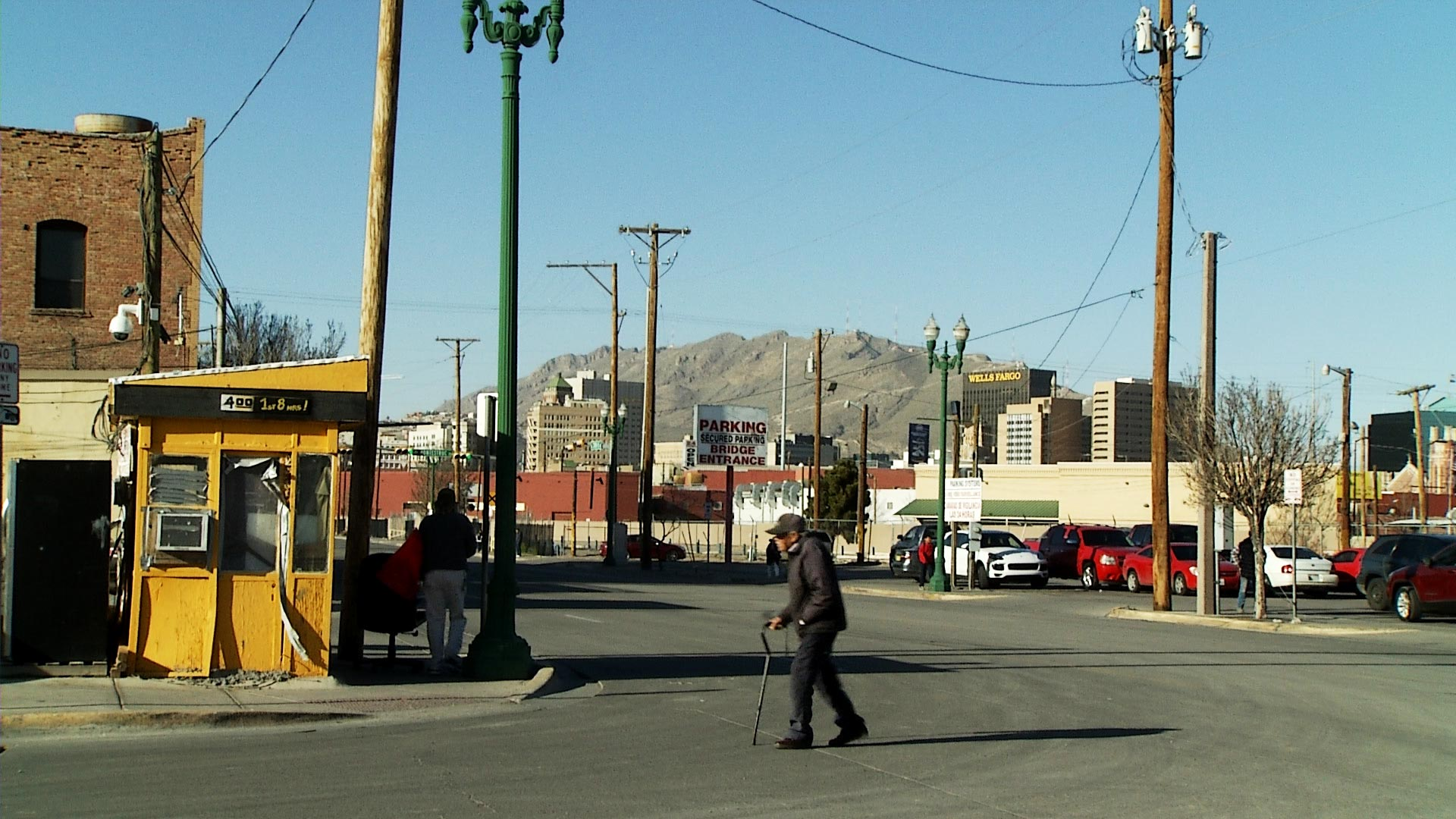 A man using a can crosses the road on the outskirts of downtown El Paso on February 11, 2019.