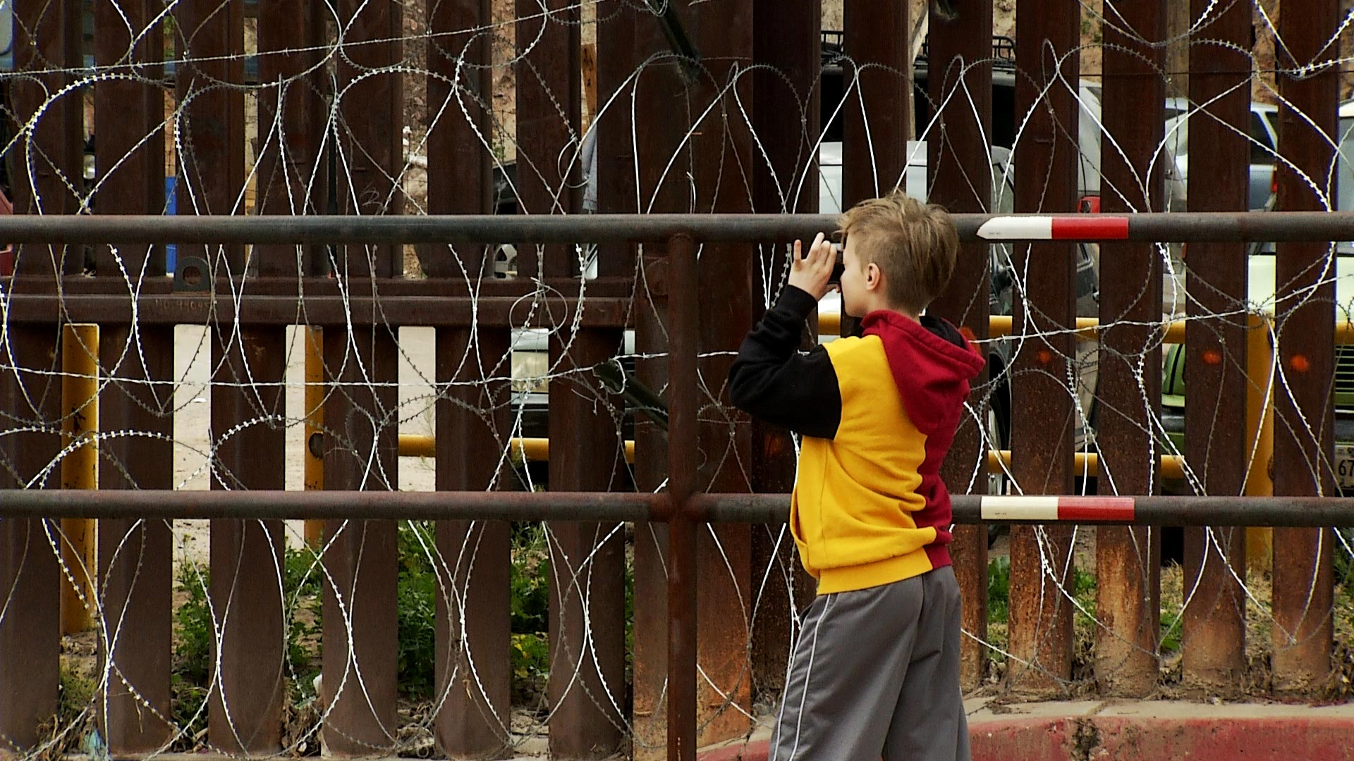 Willa Perry-Spears, 10, photographs the wall along the international line in Nogales, Arizona on February 18, 2019. It was her first time at the border.