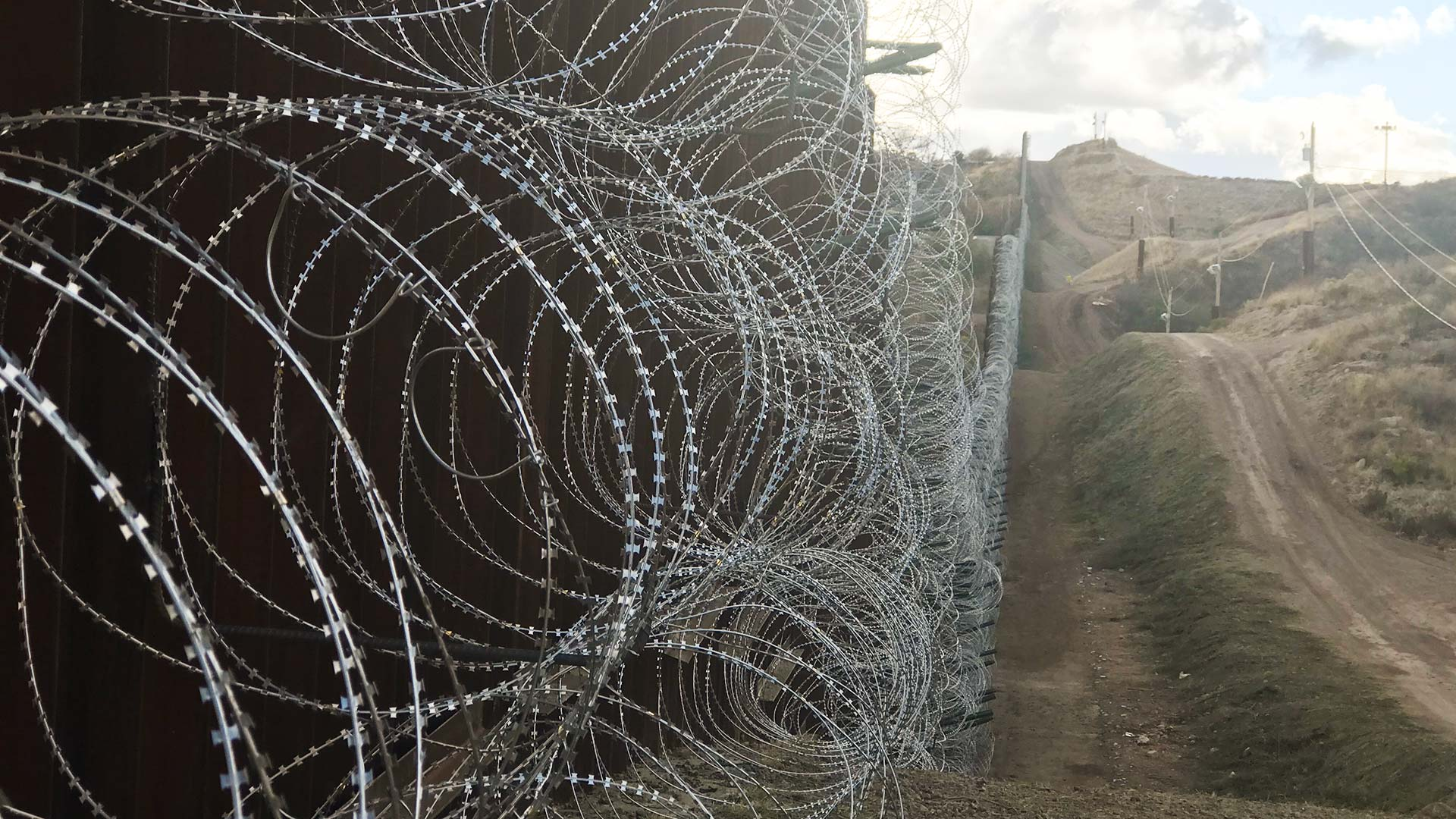 Rows of razor wire cover the U.S. side of a section of the wall near Nogales, Arizona.