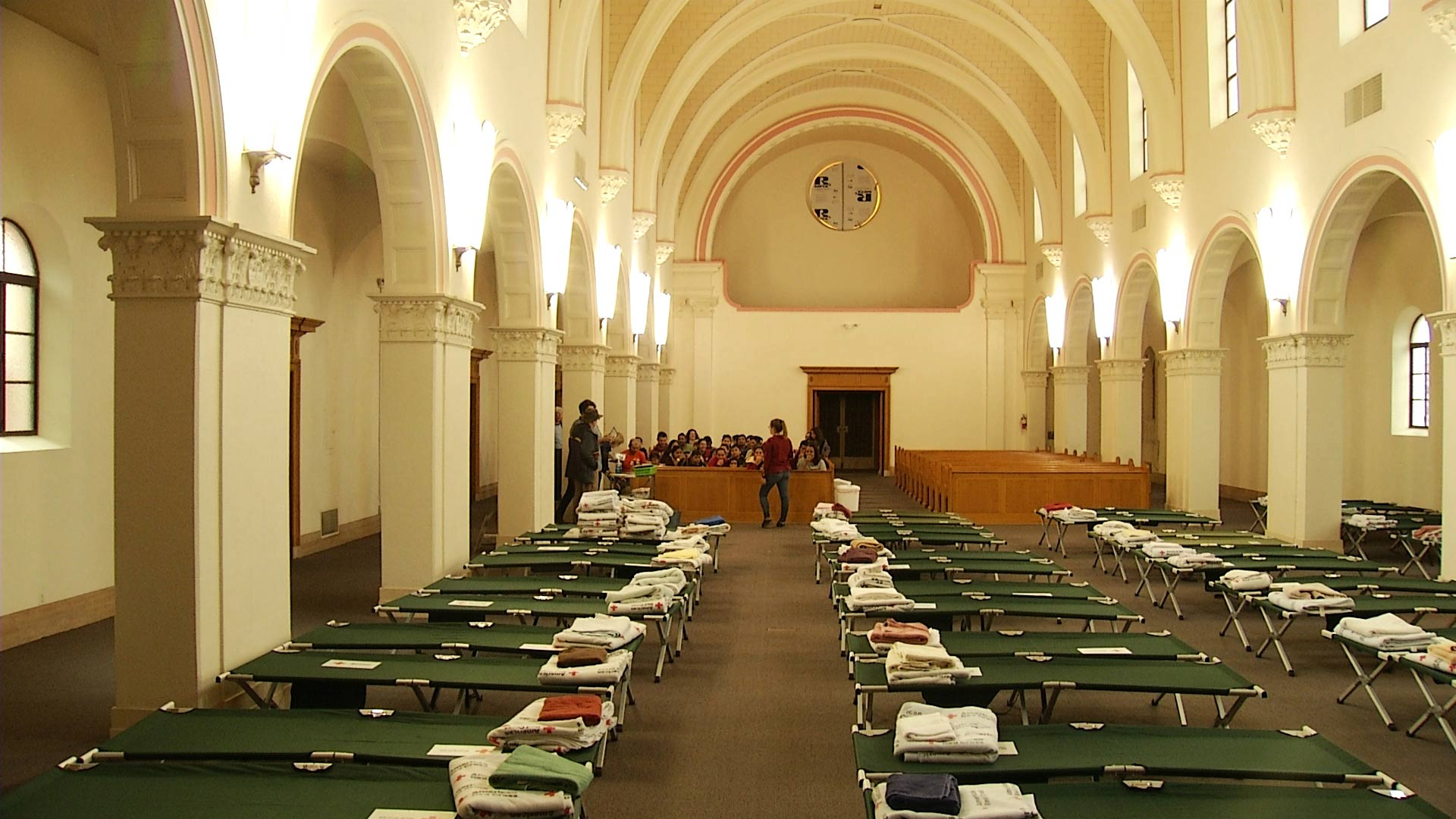 Rows of cots are set up inside the Benedictine Monastery in February 2019. The monastery served as a temporary shelter for migrant families seeking asylum.