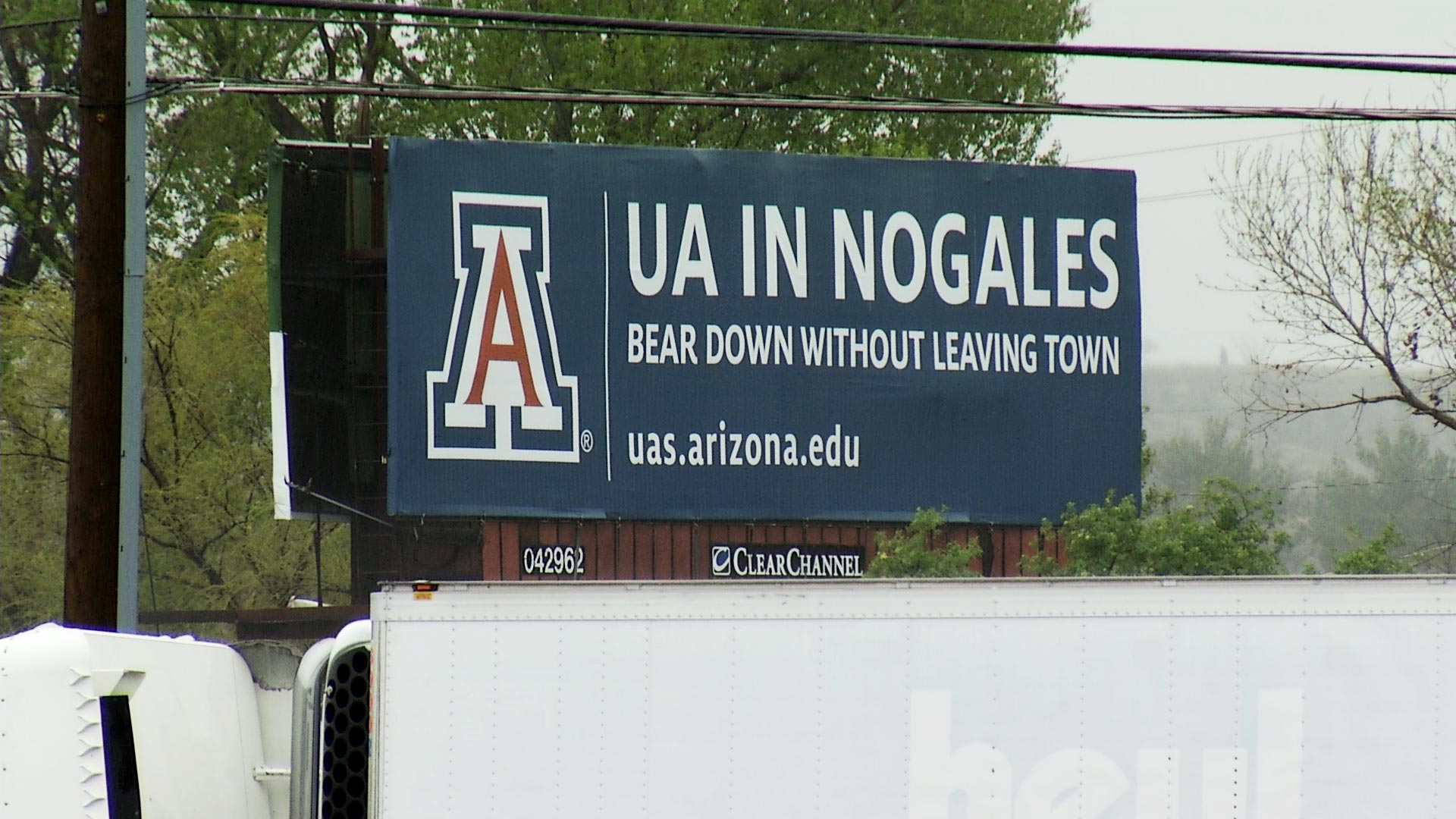 A billboard advertises University of Arizona programs offered in Nogales, Arizona.