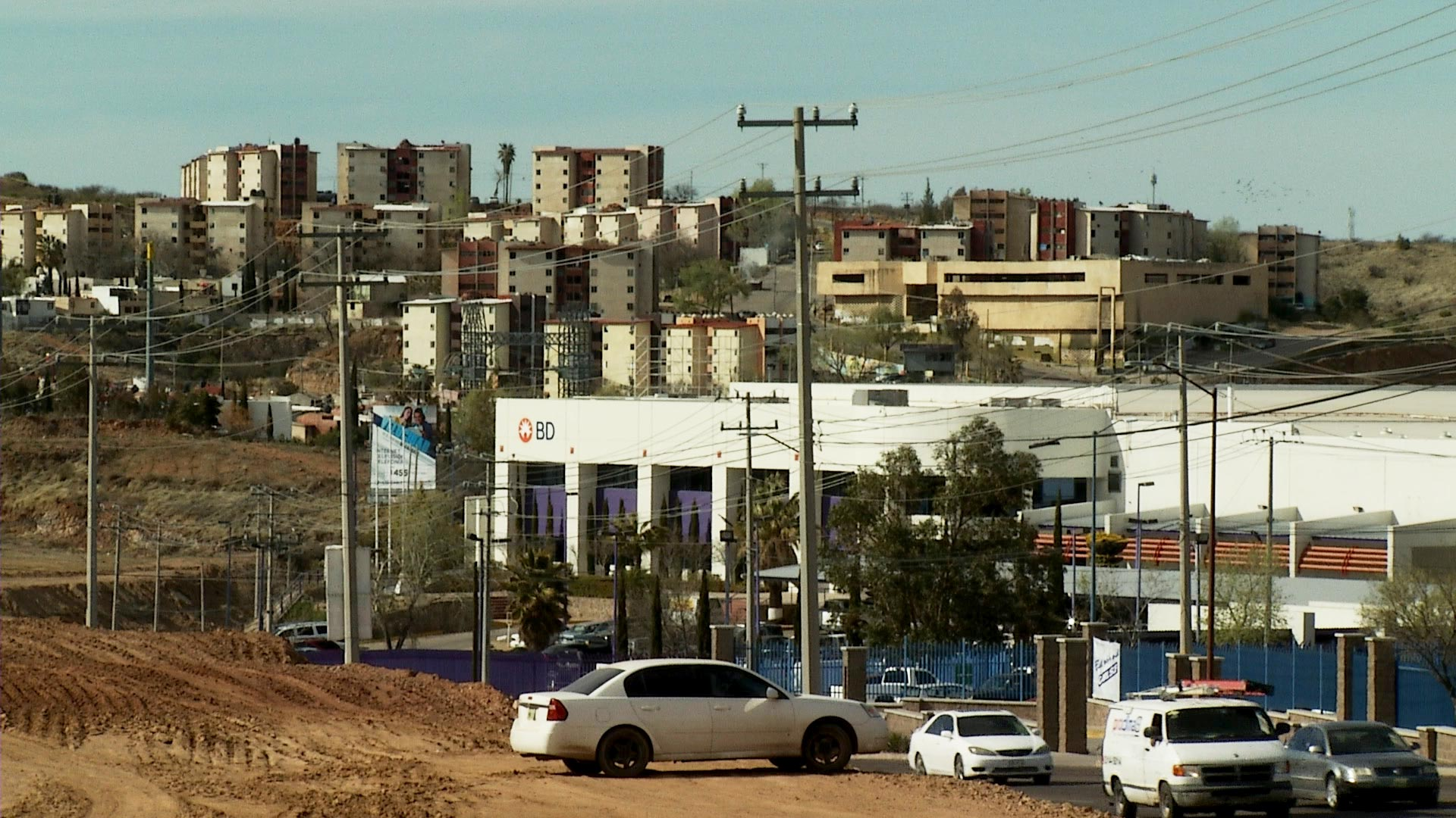 Maquilas line the road in Nogales, Sonora a few miles south of the Mariposa Port of Entry, March 2019.