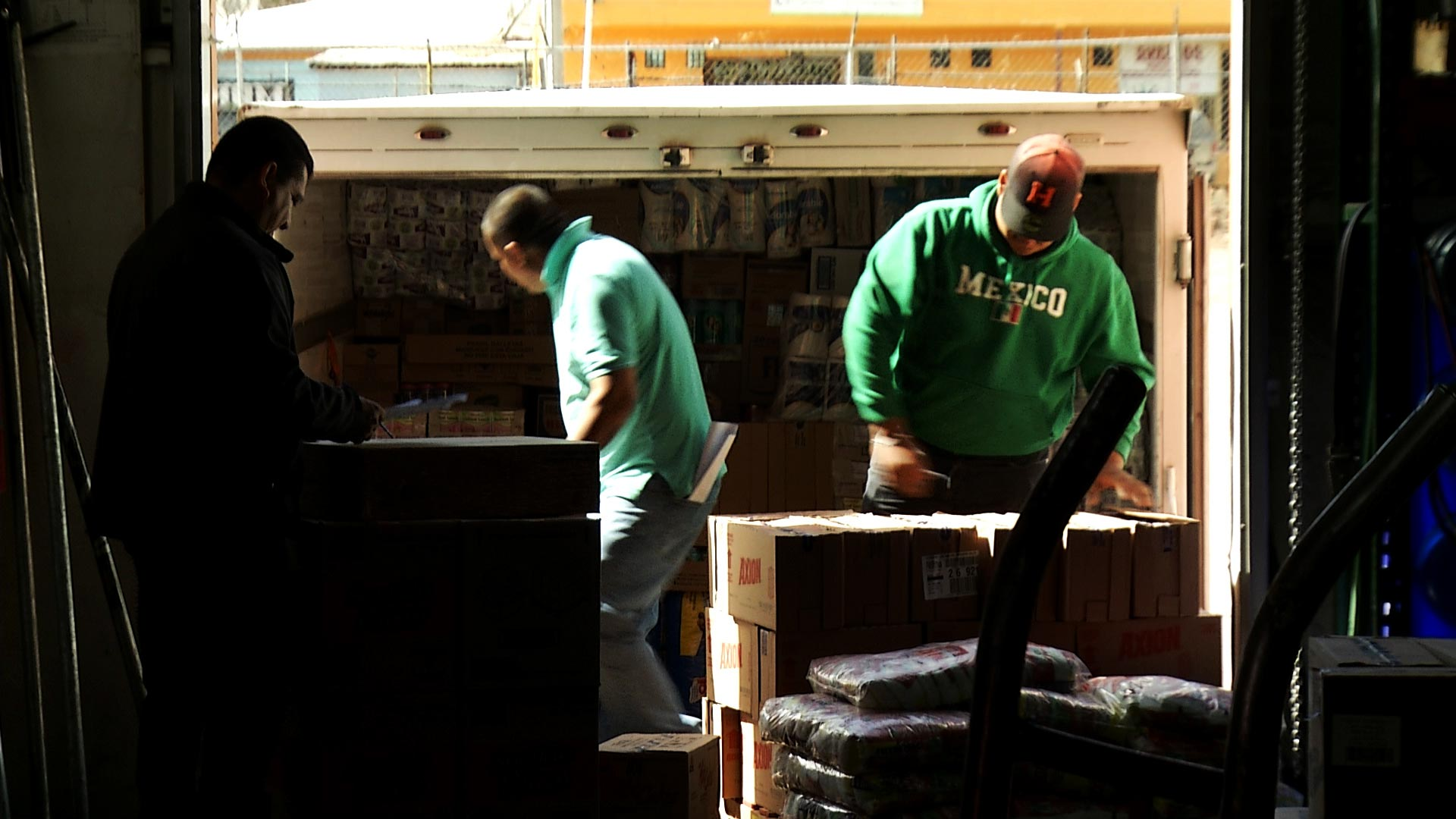Employees unload boxes from a supply truck at CS Food Service in Nogales, Sonora on March 4, 2019.