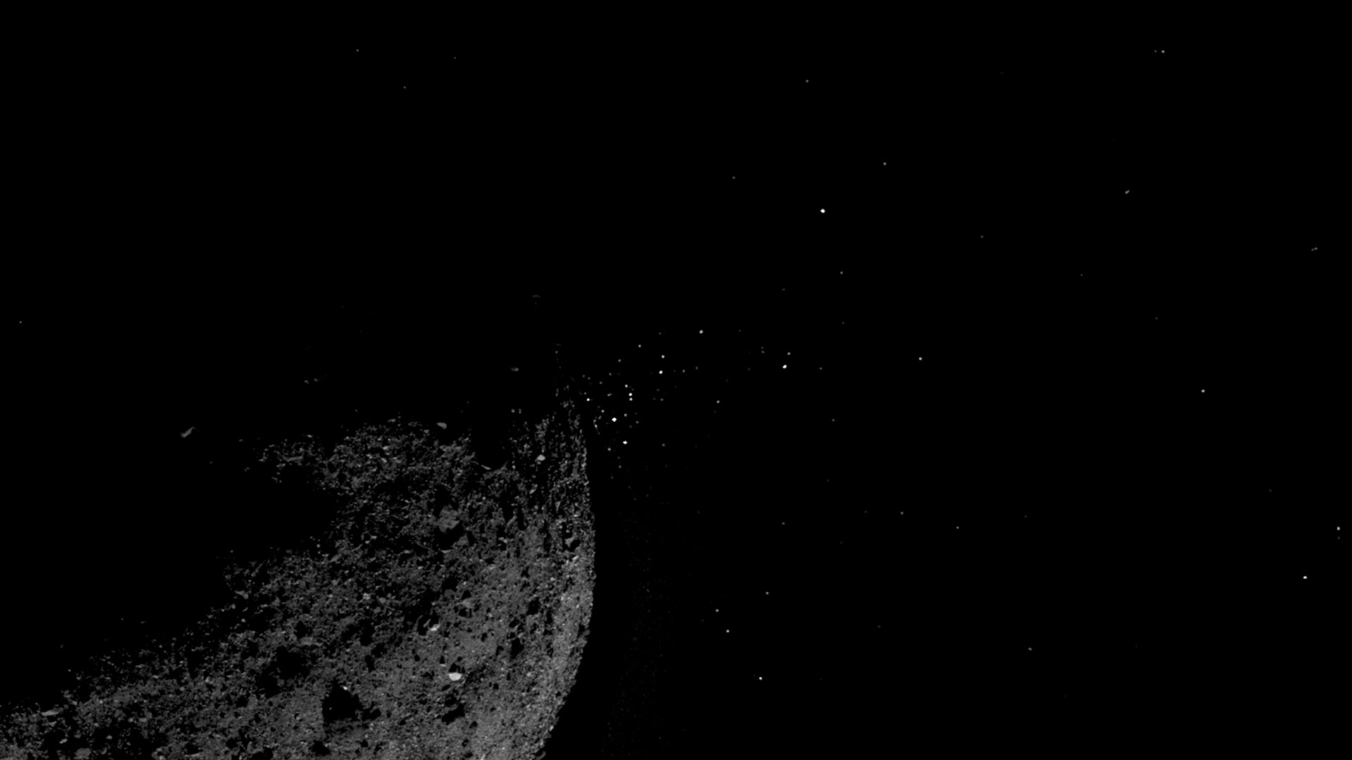 OSIRIS-REx photograph shows material being ejected from the surface of the asteroid Bennu in January 2019.