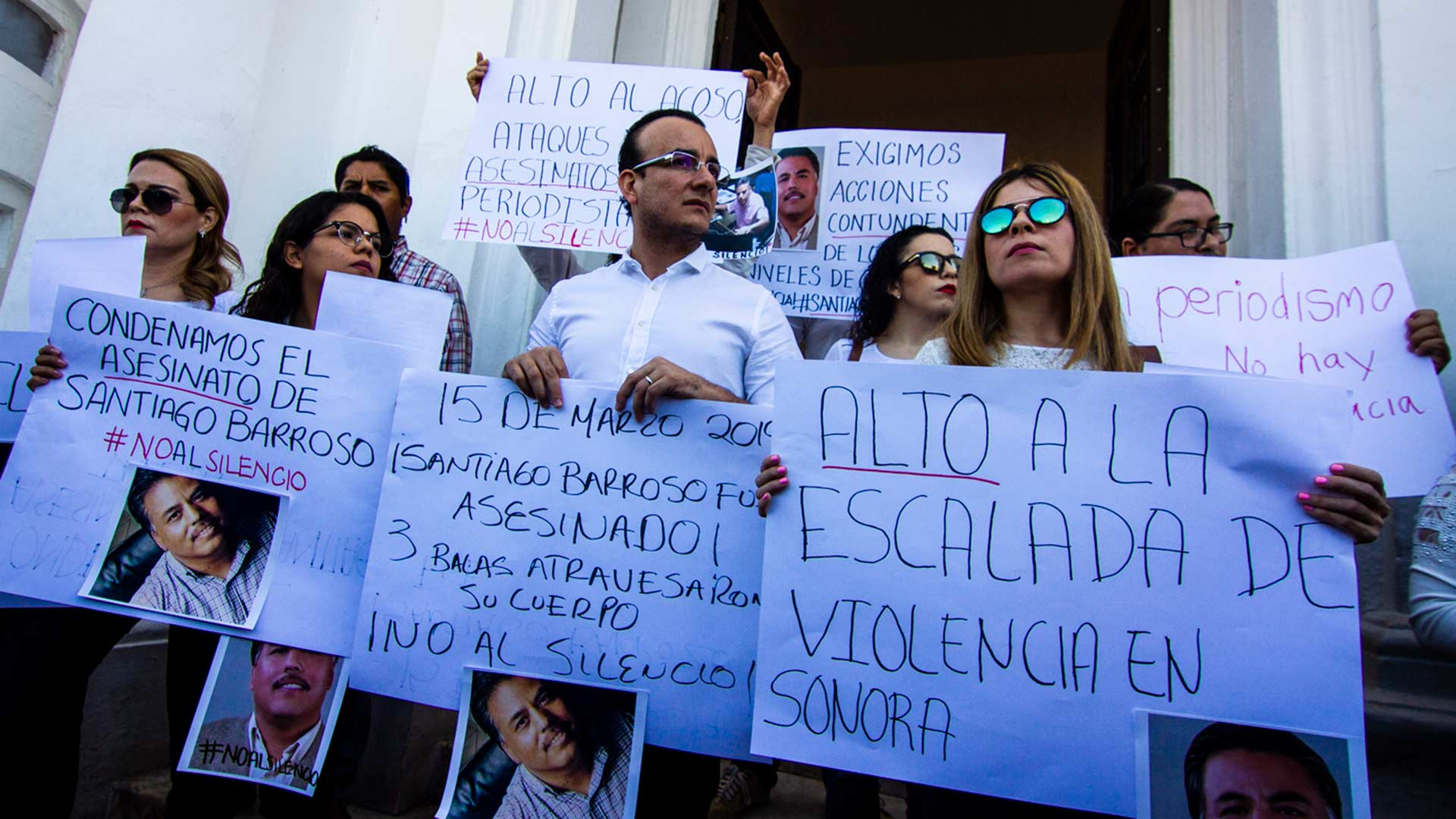 Protesting reporters stand in front of the Government Palace in Hermosillo to demand resolution of Santiago Barroso's murder as well as broader protection of press freedom.