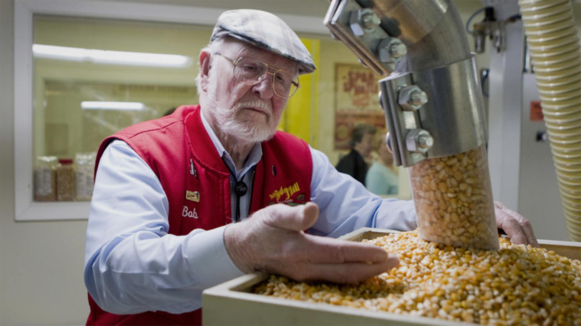 Bob Moore, founder of Bob's Red Mill Natural Foods, inspects grains at the company's facility in Milwaukie, Ore. The pioneering manufacturer of gluten-free products invests in whole grains as well as beans, seeds, nuts, dried fruits, spices and herbs.