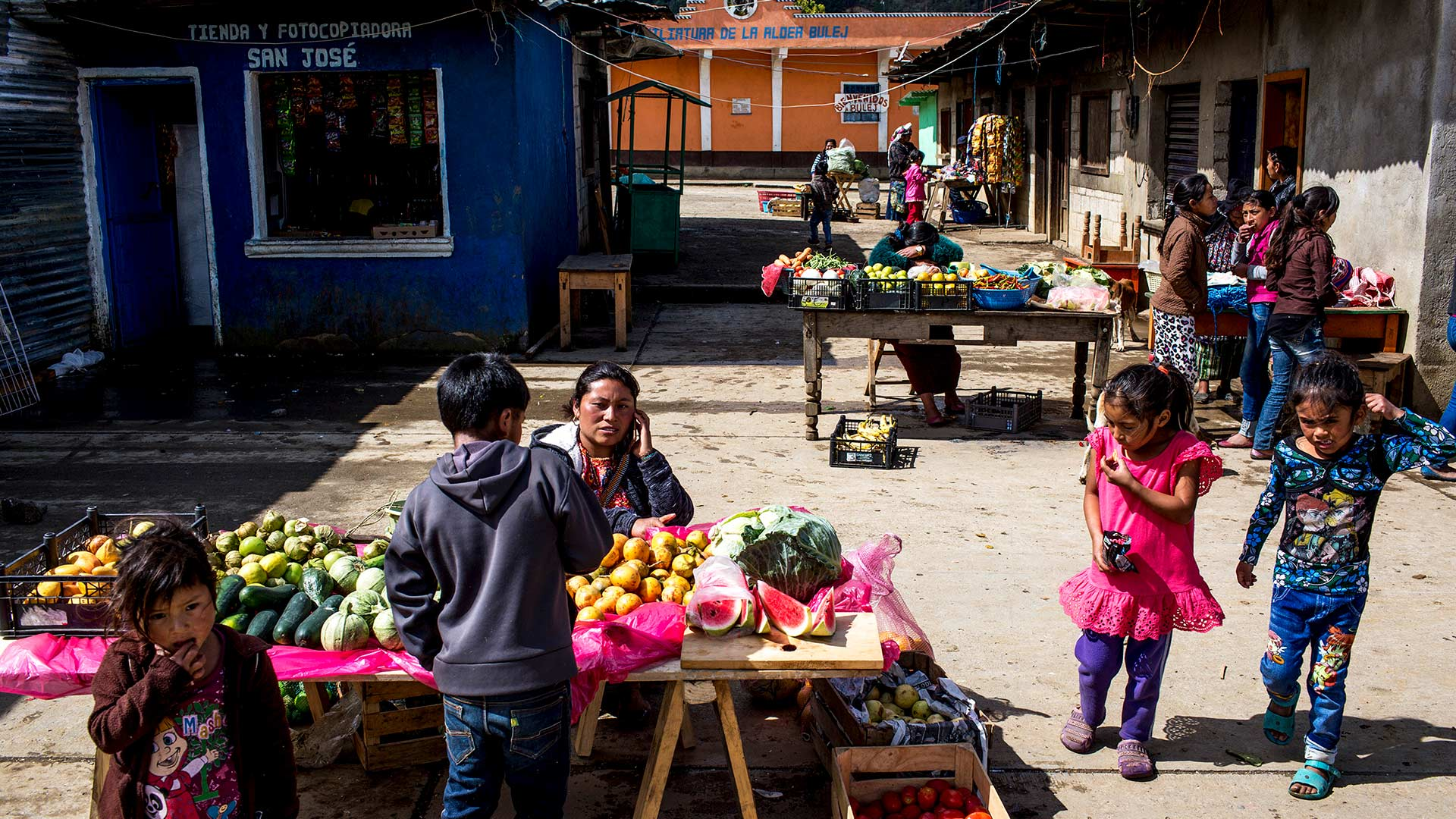 A market in Bulej, in the western highlands of Guatemala. Bulej is among communities that have seen a new pattern of migration: parents traveling with younger children.