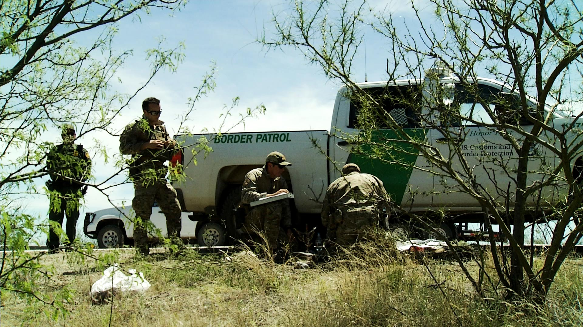 Agents with the Border Patrol Search, Trauma and Rescue team (BORSTAR) provide first aid to a man (not pictured) who flagged down a car for help off a highway in Pima County on April 9, 2019. The man told agents he was from Guatemala and had been lost the desert for several days.