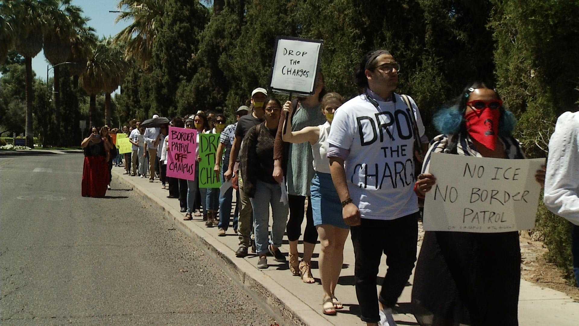Protesters make their way to Old Main at the University of Arizona on April 10, 2019. They were demonstrating in support of three students cited for protesting a presentation given in a classroom by Border Patrol agents in March.