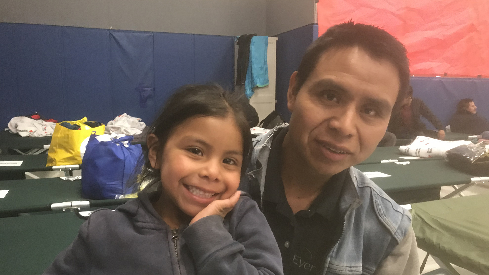 Guatemalan father with his 5 year old daughter.  It took father and daughter almost two weeks to get to the Arizona border.  They are asylum seekers staying at a temporary shelter opened by the City of Tucson to relieve the overflow of migrants at Tucson shelters.  (April 18, 2019)
