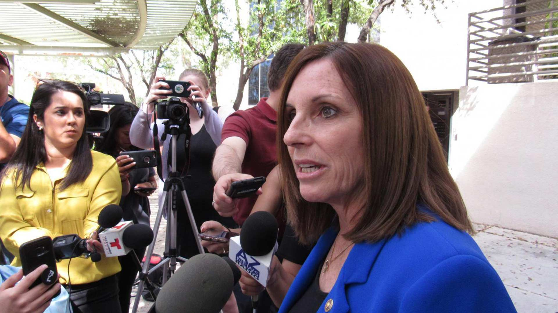 U.S. Sen. Martha McSally answers questions from reporters outside the Phoenix office of U.S. Immigration and Customs Enforcement on April 1, 2019.
