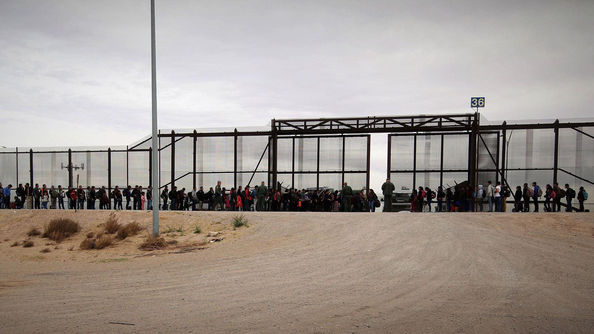 This March 7, 2019 Customs and Border Protection photo shows a group of more than 100 migrants lined up at the border in the El Paso Sector.