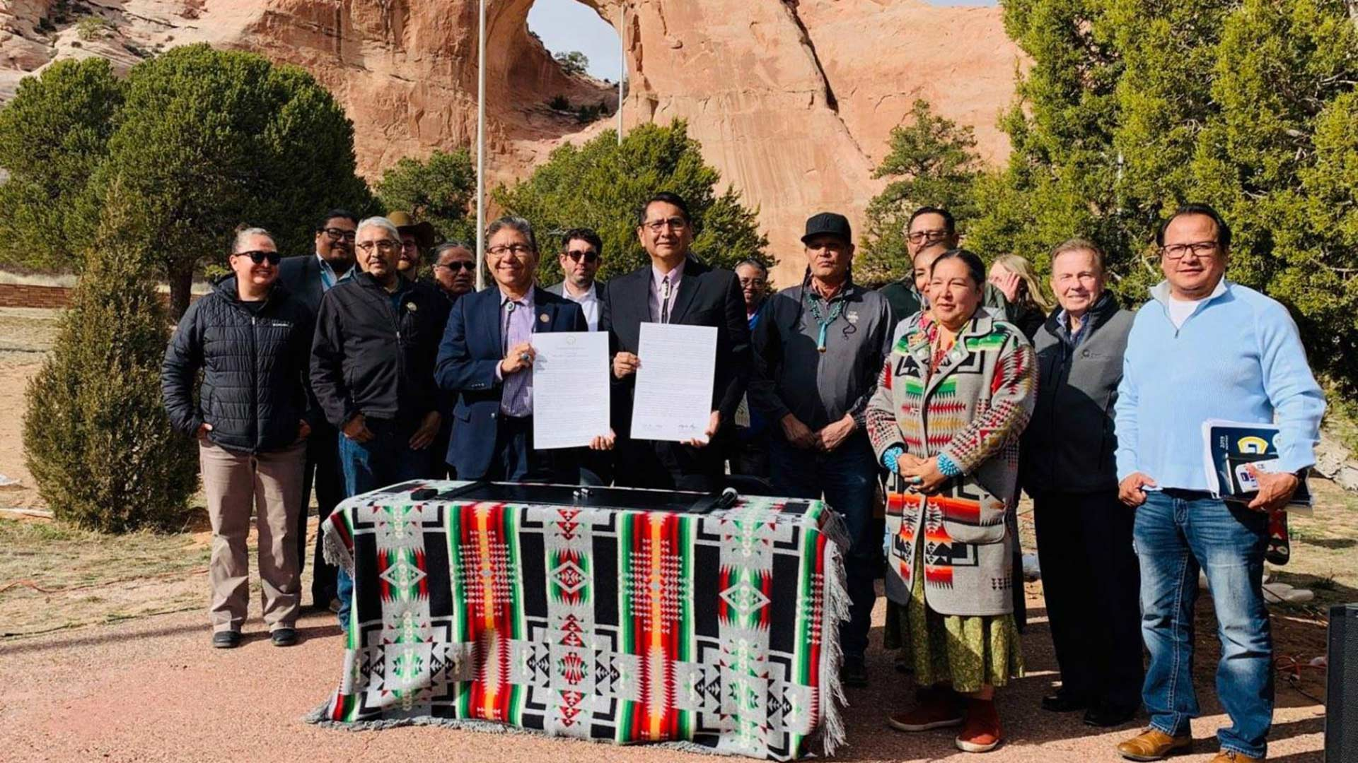 Navajo National Vice President Myron Lizer and President Jonathan Nez hold up the Navajo Sunrise Proclamation in Window Rock, the tribe's capital, on April 2, 2019.