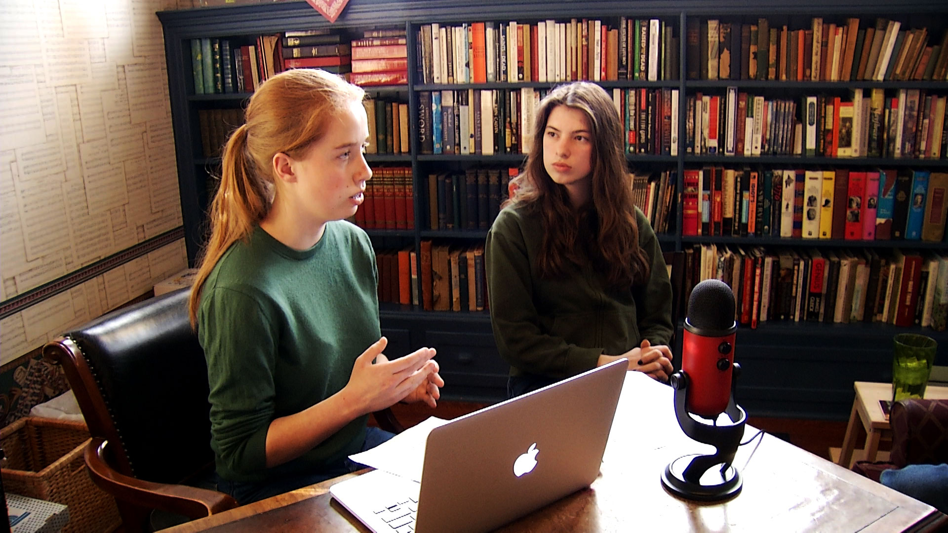 Grace Proebsting (left) and Rose Long conduct an interview for their podcast Gosh Darn Podcast at the Z Mansion in Tucson on February 26, 2019. The teens are students at University High School and developed the podcast for their Varsity Economics club.