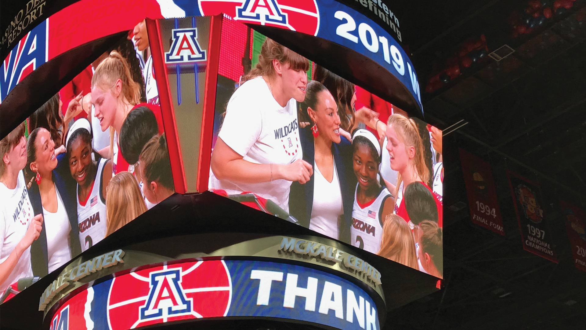 UA Women's basketball coach Adia Barnes celebrates with her team after winning the Women's National Invitation Tournament championship at McKale Center in Tucson, April 6, 2019.