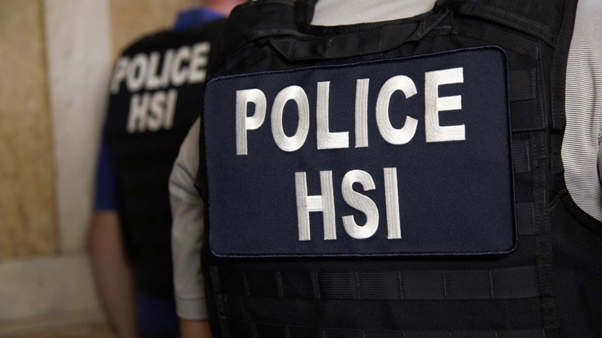 Department release photo of police with Immigration and Customs Enforcement's (ICE) Homeland Security Investigations (HSI).