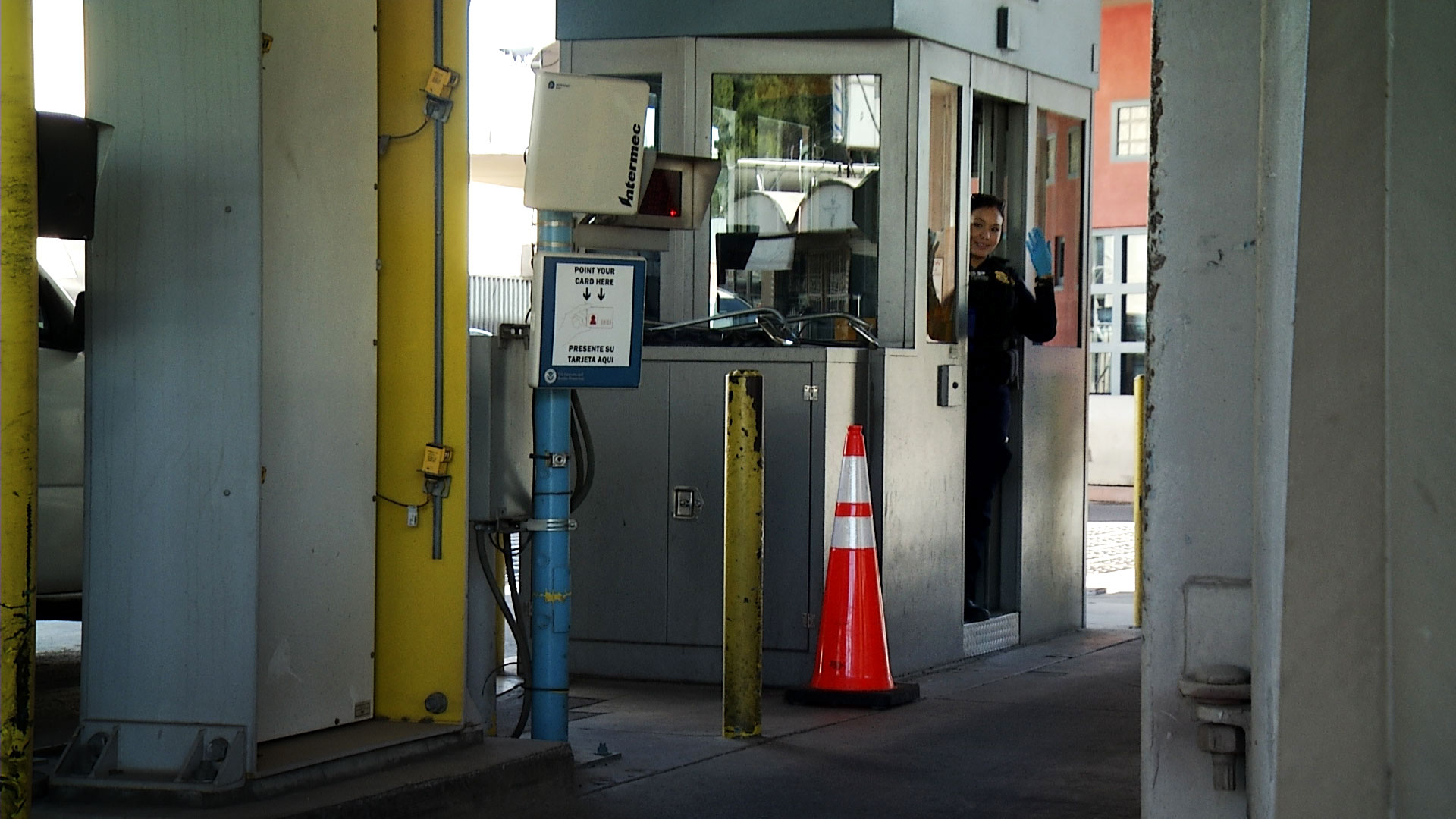 A customs officer waves at a vehicle to move forward at the Dennis DeConcini Port of Entry in Nogales on May 15, 2019.