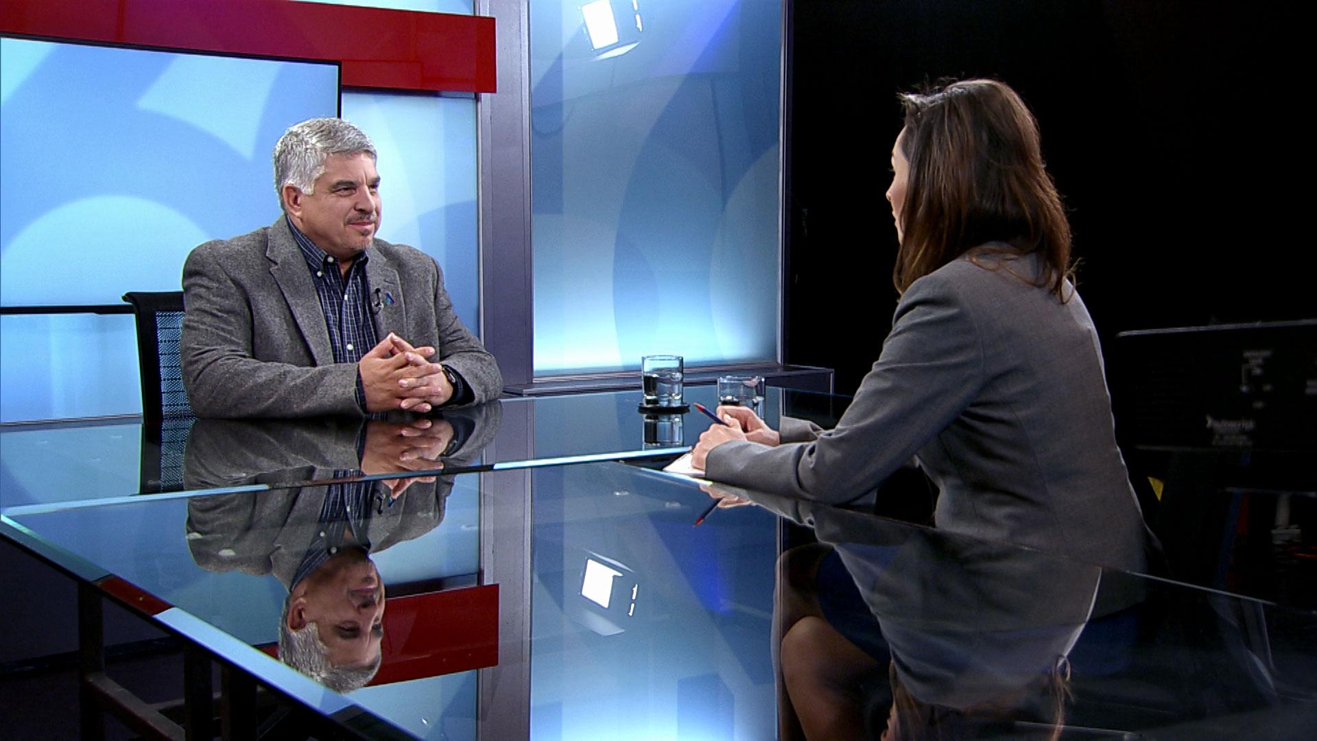 Tony Coulson, retired head of the DEA in Tucson, sits across from Arizona 360 host Lorraine Rivera in Arizona Public Media's studio on May 14, 2019.