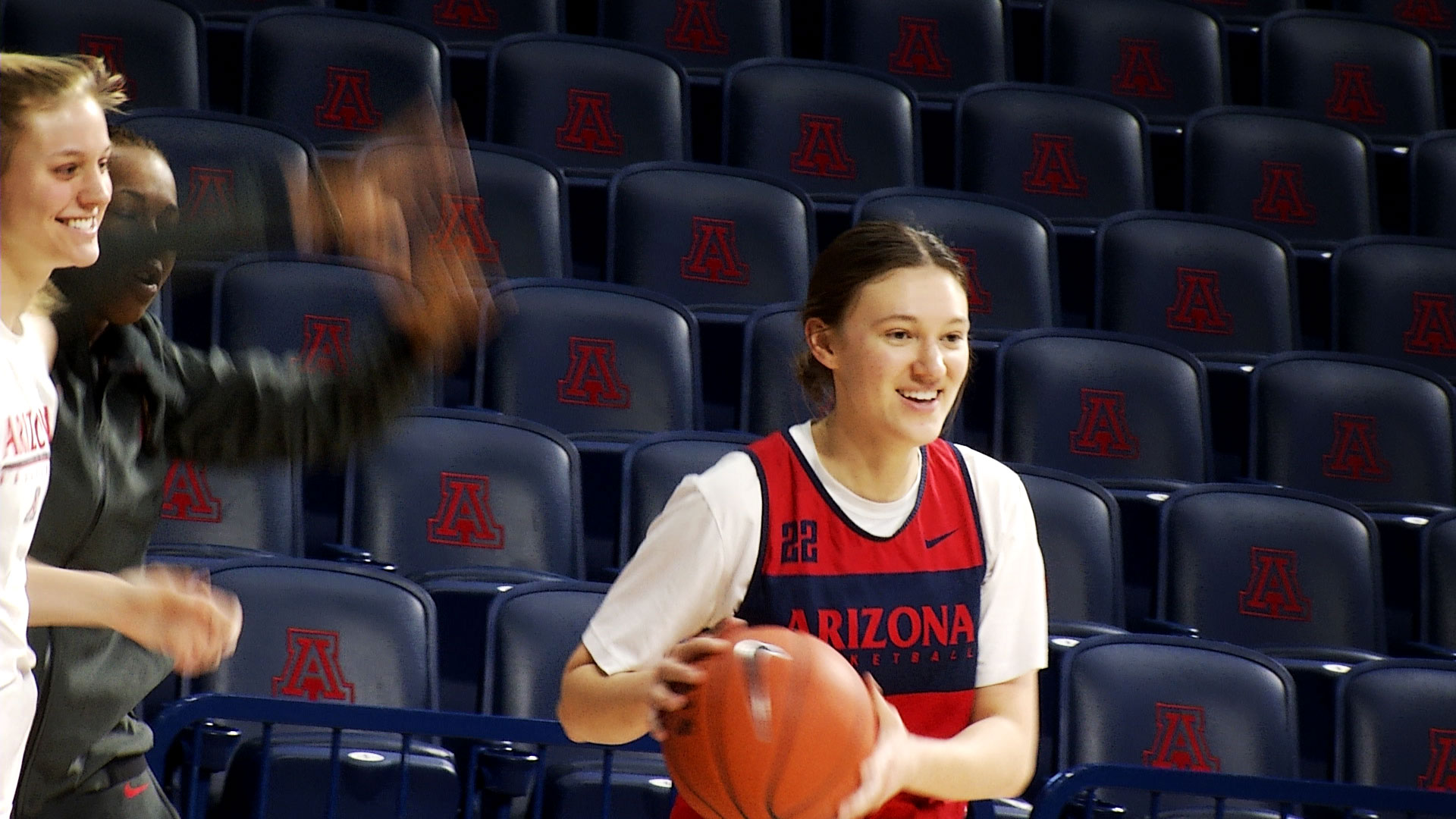 Lindsey Malecha warms up with her UA Women's Basketball teammates at the McKale Memorial Center in January 2019.