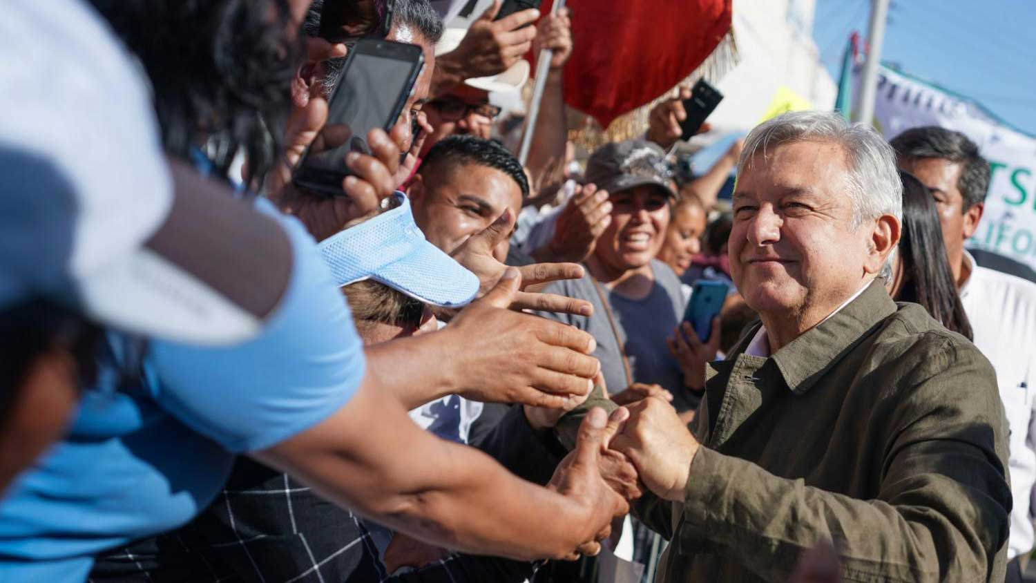 Mexican President Andrés Manuel López Obrador is greeted by supporters in Tijuana, Mexico, before a rally, in this photo dated June 8, 2019.