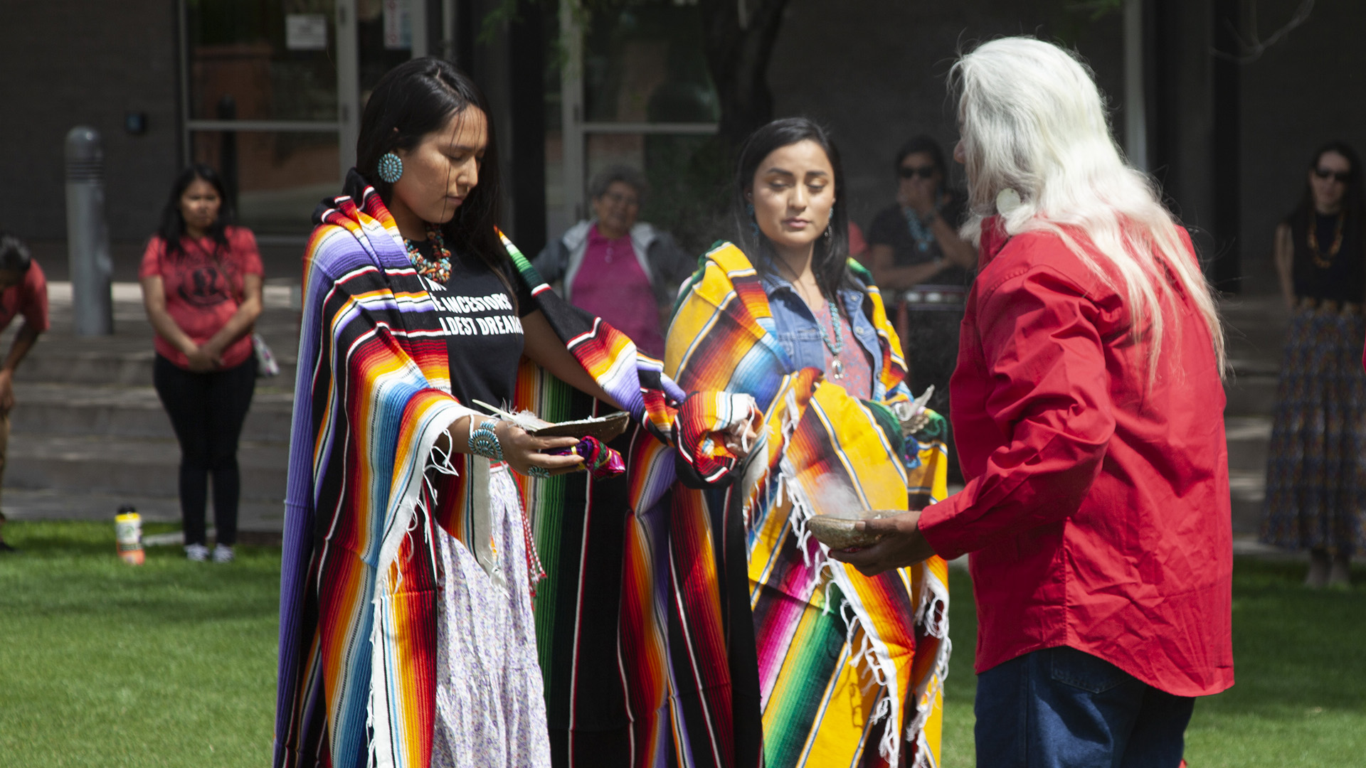 Two medical students from the graduating class of 2019 participate in a blessing ceremony May 10, 2019, that honored the work they've done in their program.