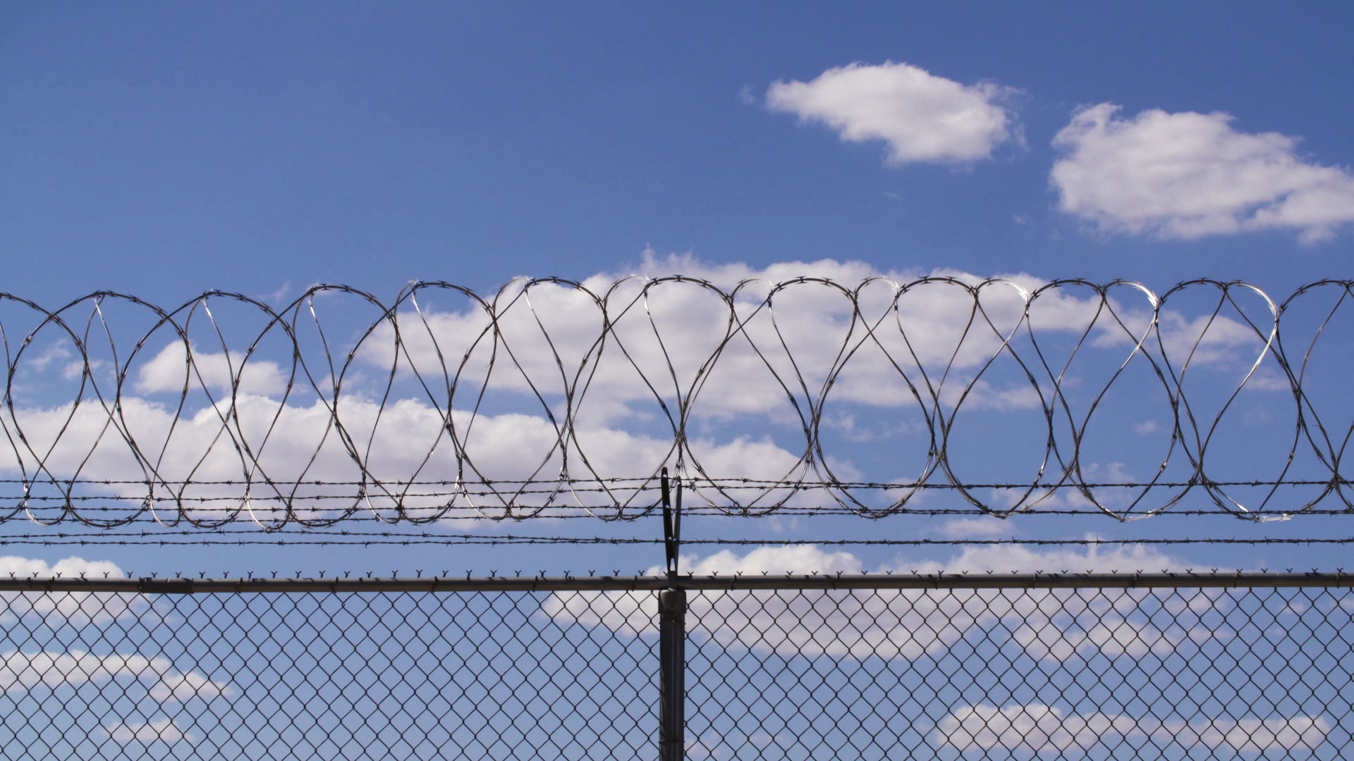 File image of razor wire lining a fence at a state prison in Arizona.