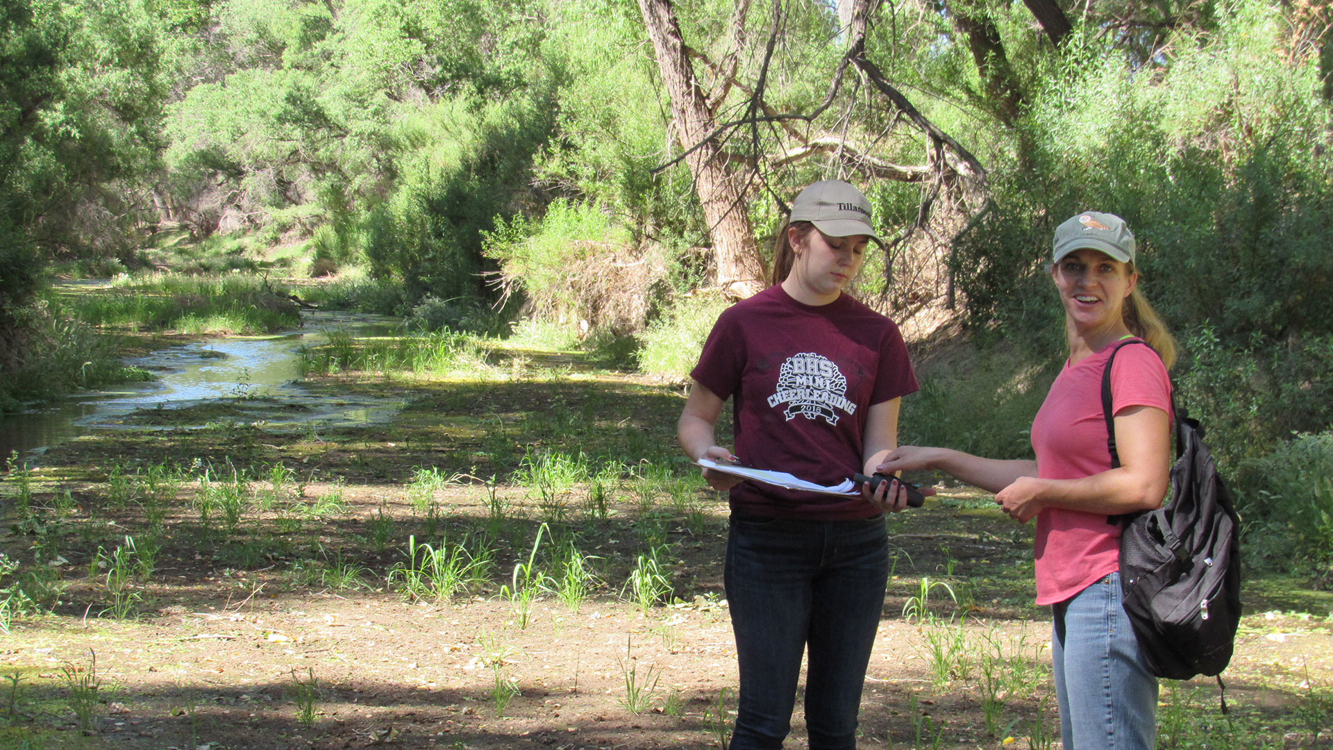 Volunteers Sara Ransom and Kaya Foss doing wet-dry mapping on the San Pedro River.