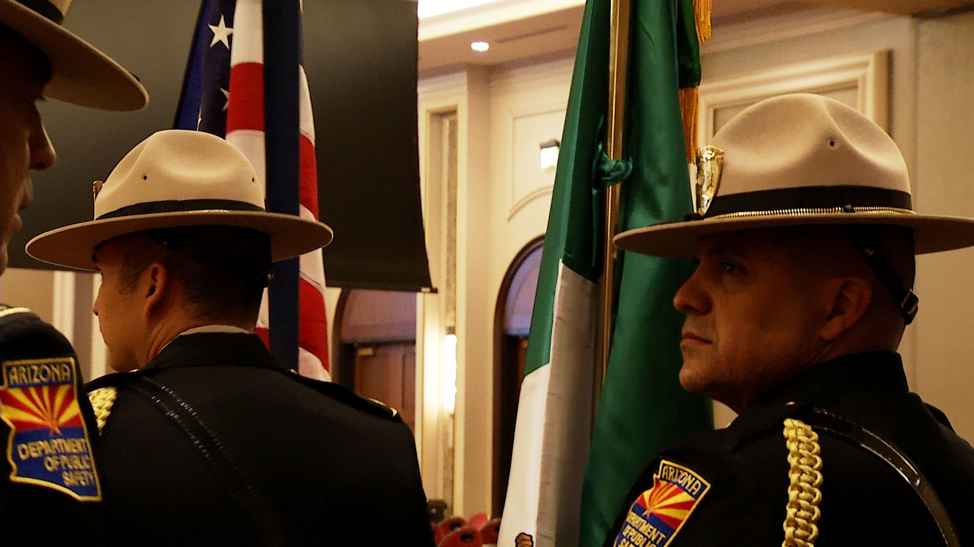 Members of the Arizona Department of Public Safety's Honor Guard stand with United States and Mexican flags at the annual PISA conference held at Casino Del Sol in Tucson on June 19, 2019. The event brings together law enforcement agencies in Arizona and Sonora, Mexico.
