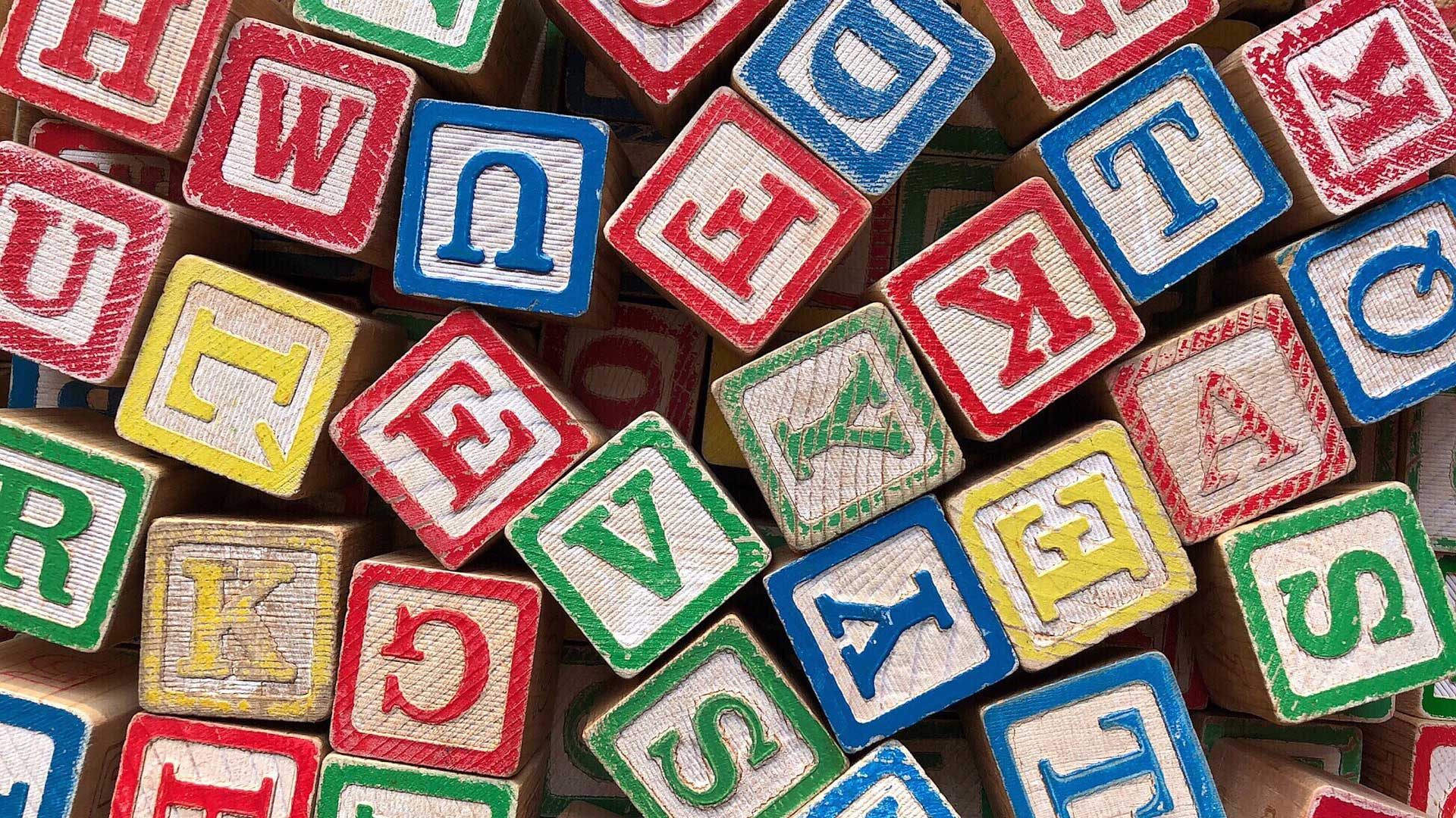 Toy blocks with letters on them.