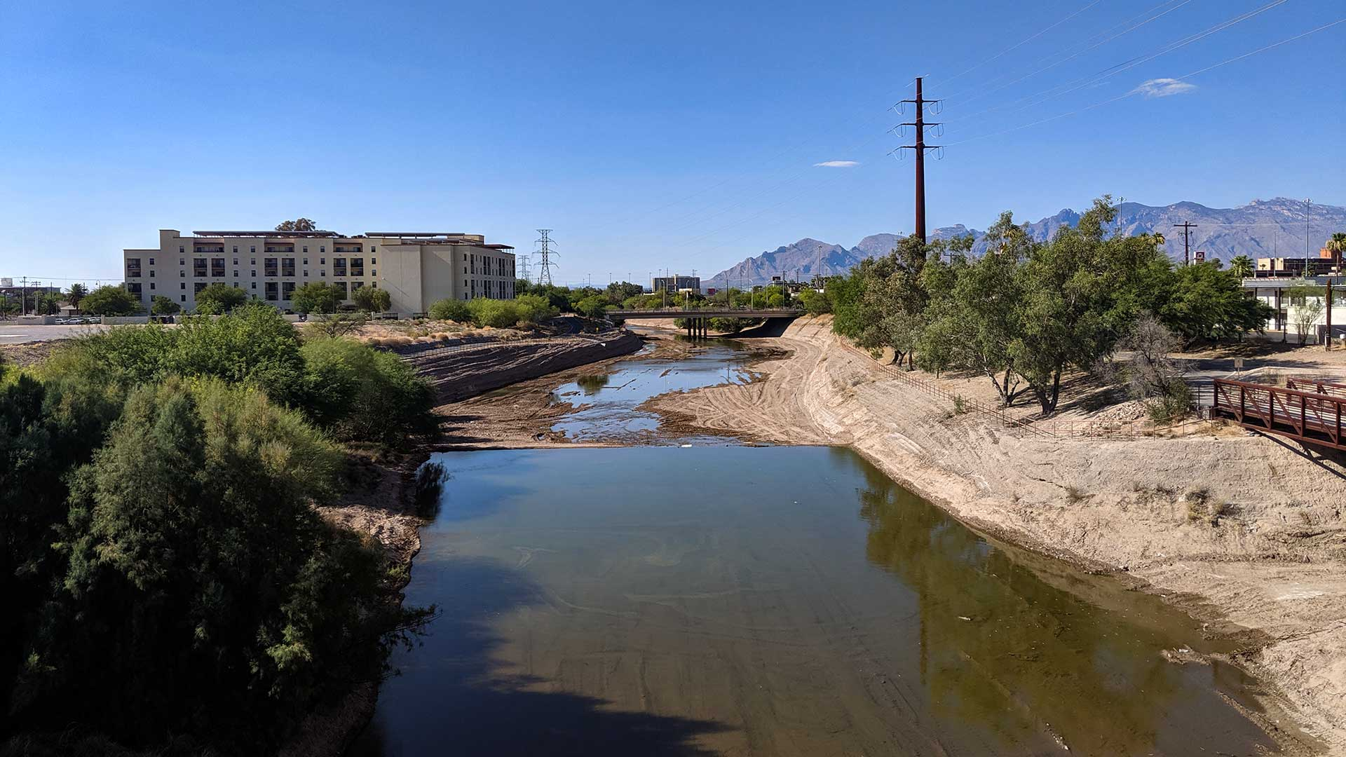 Water flows north of Cushing Street in the Santa Cruz River, midway through the first week of a project aiming to create a perennial flow in a section of the river, June 27, 2019.