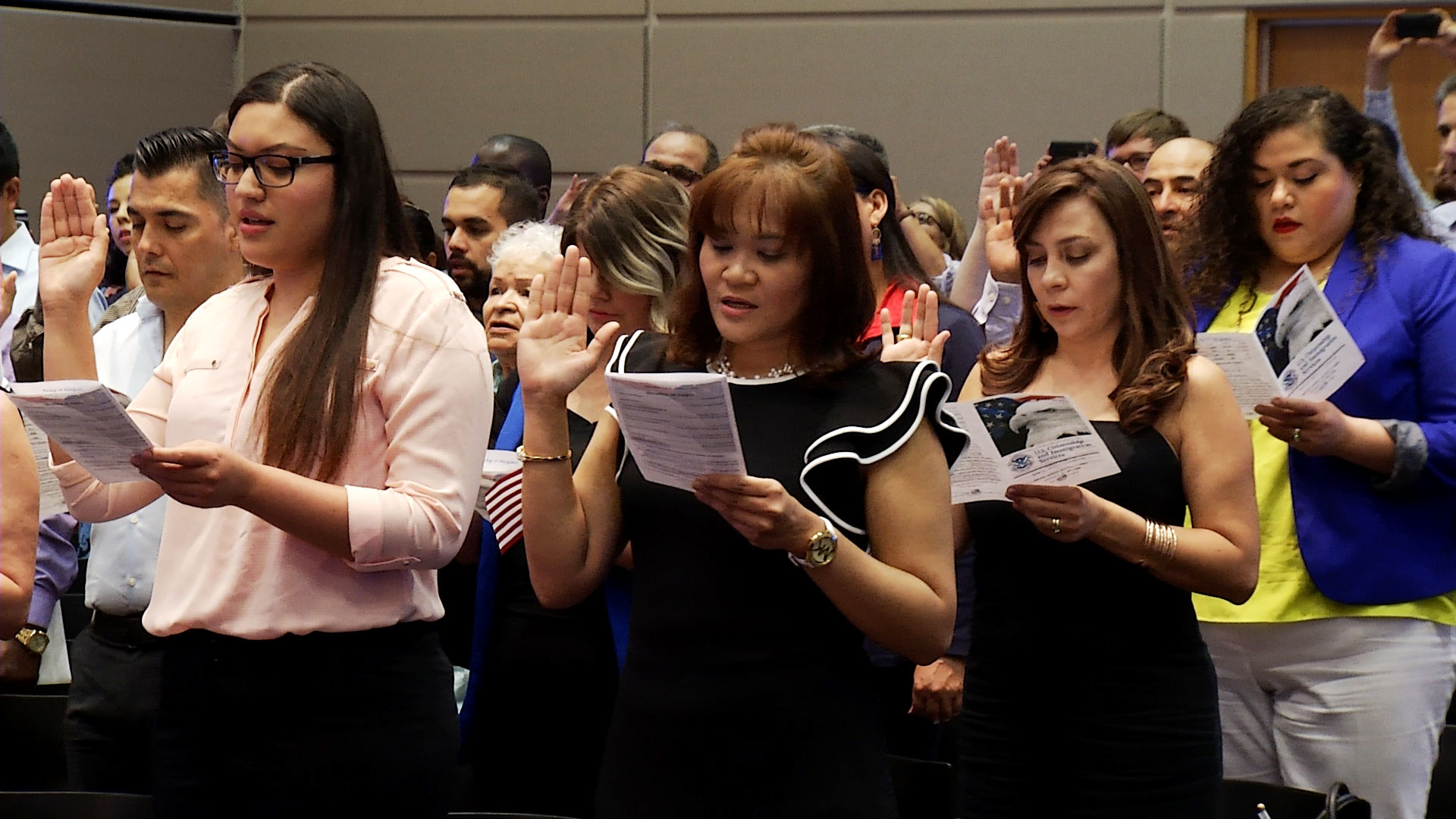 Immigrants take their Oath of Allegiance at a naturalization ceremony held at the U.S. District Court in Tucson on June 21, 2019.