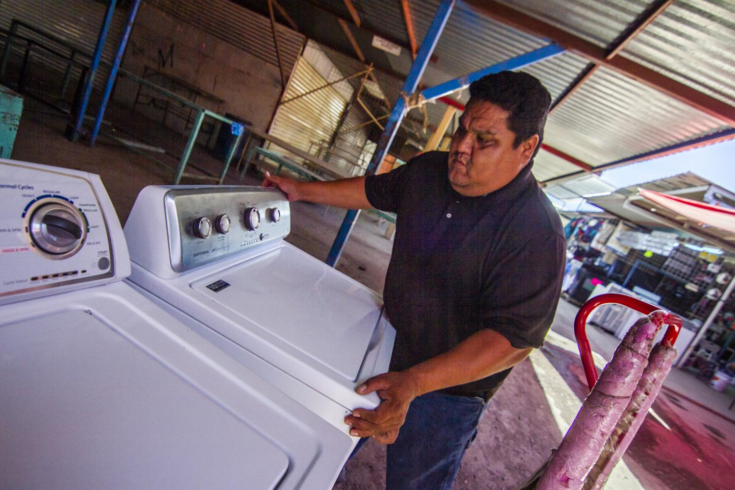 Said Bracamontes makes his living hauling used Arizona washers back Sonora and fixing them up for resale.