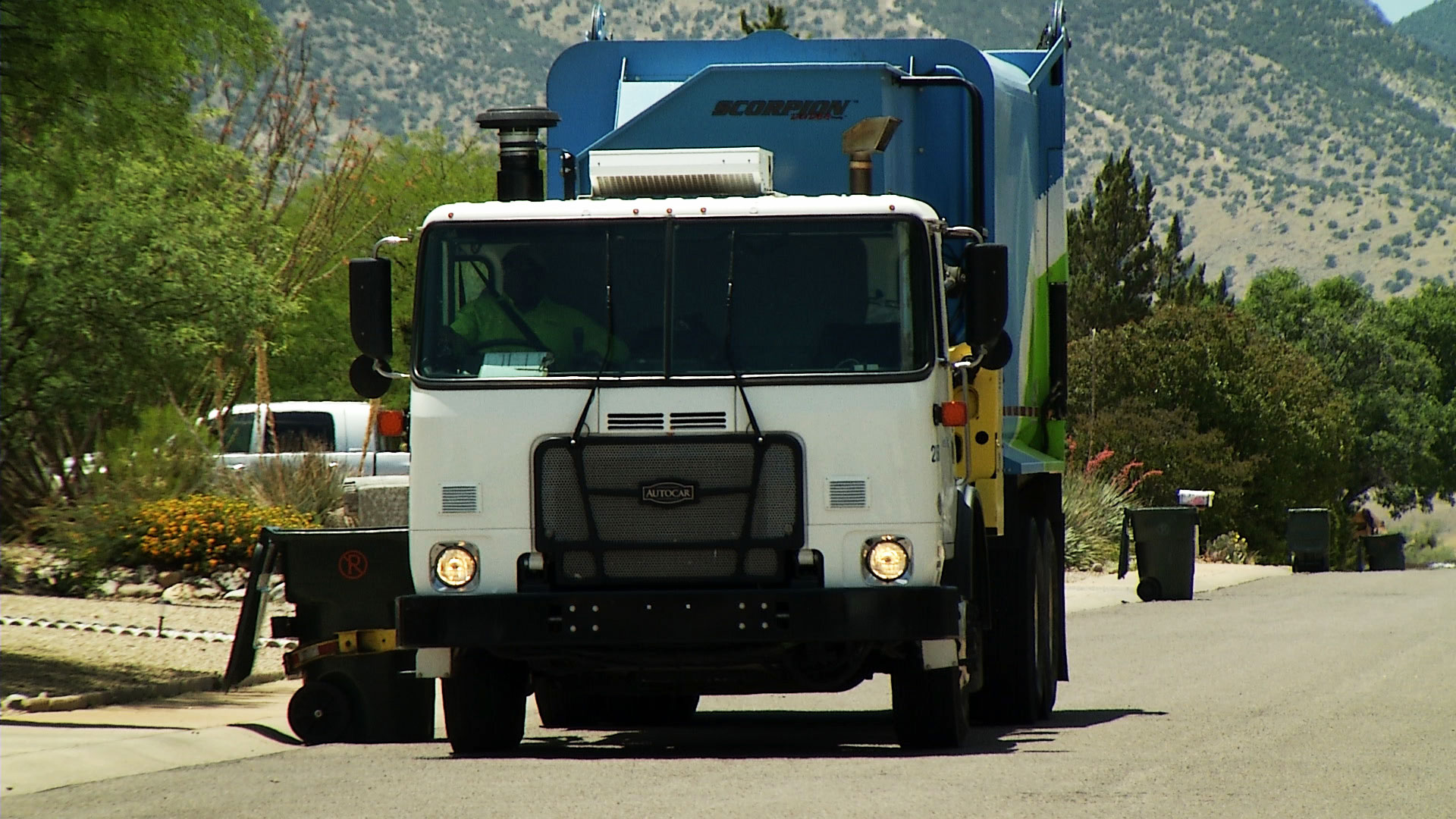 A garbage truck picks up trash bins from the curb in Sierra Vista on June 4, 2019.