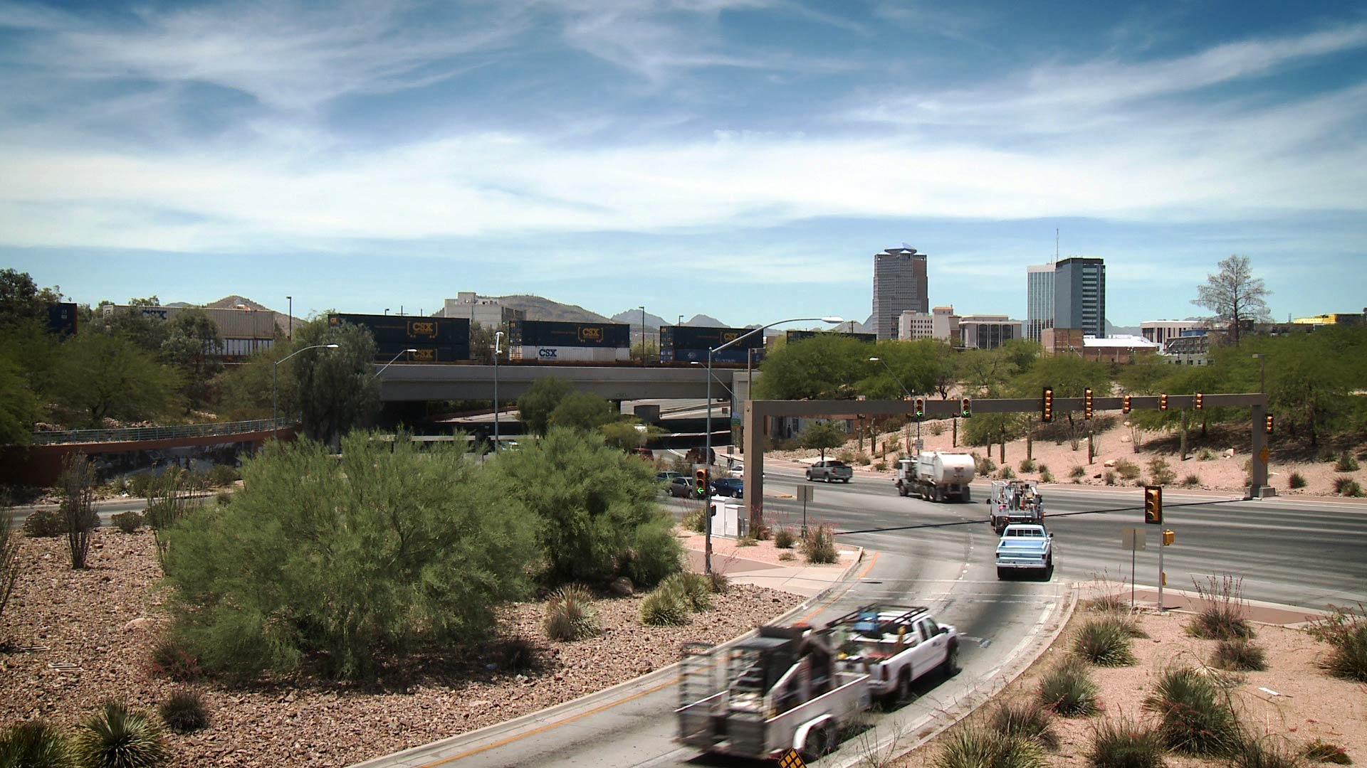 Downtown Tucson seen from the intersection of Barraza Aviation Highway and East Broadway Boulevard.
