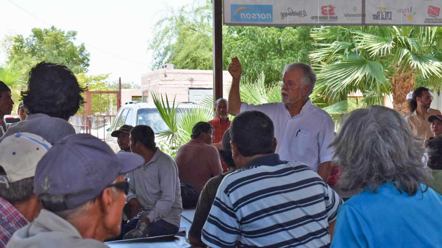 Rev. Robin Hoover speaks to migrants at a soup kitchen in Hermosillo, Sonora, on July 8, 2019.