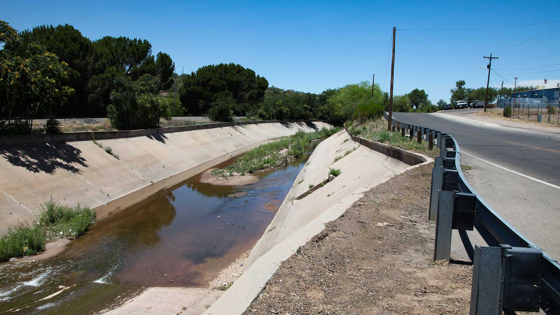 The International Outfall Interceptor, or IOI, runs under this concrete-lined wash through the city of Nogales, Ariz.