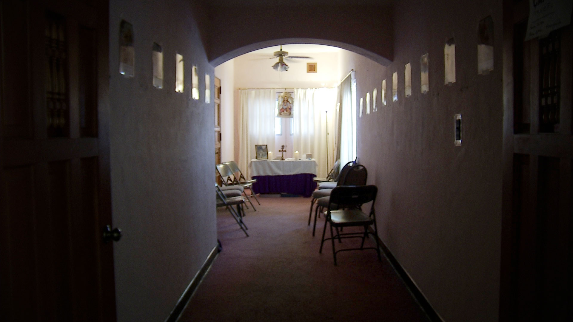 An altar at the end of a hallway inside the Benedictine Monastery in Tucson.