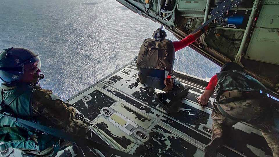 Pararescue jumpers from the 563rd Rescue Group at Davis-Monthan Air Force Base prepare to parachute to a fishing vessel in the Pacific Ocean, July 2019