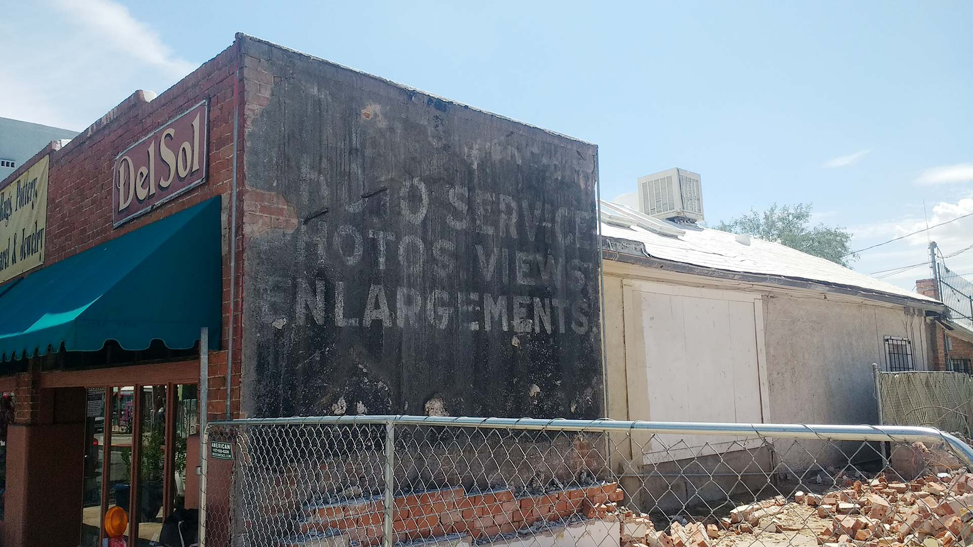 "A sign for a long forgotten photography studio on Fourth Avenue was revealed when the building housing the Flycatcher bar was torn down. The Historic Fourth Avenue Coalition wants the decades-old ""ghost sign"" preserved as the Union on Sixth project is built next door."